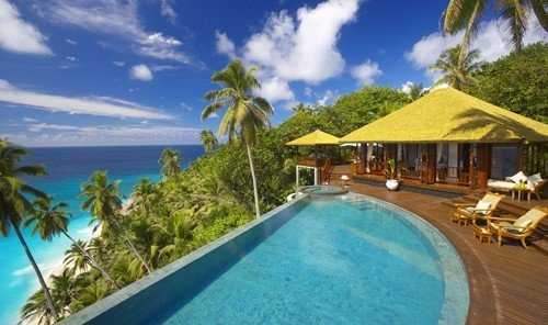 Hotels tree outdoor swimming pool property caribbean Resort leisure vacation Villa estate real estate bay eco hotel blue