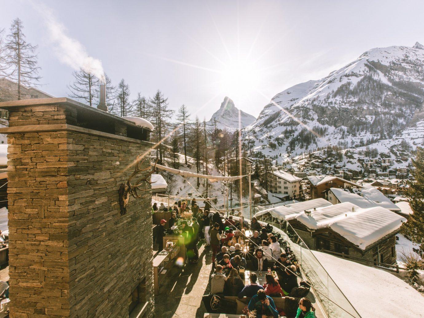 Food + Drink Mountains + Skiing sky outdoor snow geological phenomenon mountain range mountain tourism Resort alps house