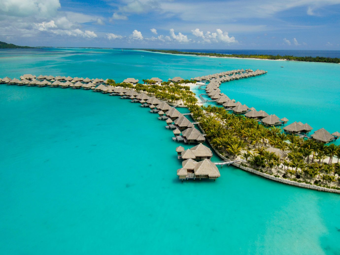 All-Inclusive Resorts Beach Boutique Hotels Hotels Island Overwater Bungalow Romance Scenic views Tropical water sky outdoor archipelago geographical feature Boat landform Ocean Sea caribbean Nature reef Coast islet bay vacation Lagoon aerial photography atoll cape inlet cay cove blue swimming shore