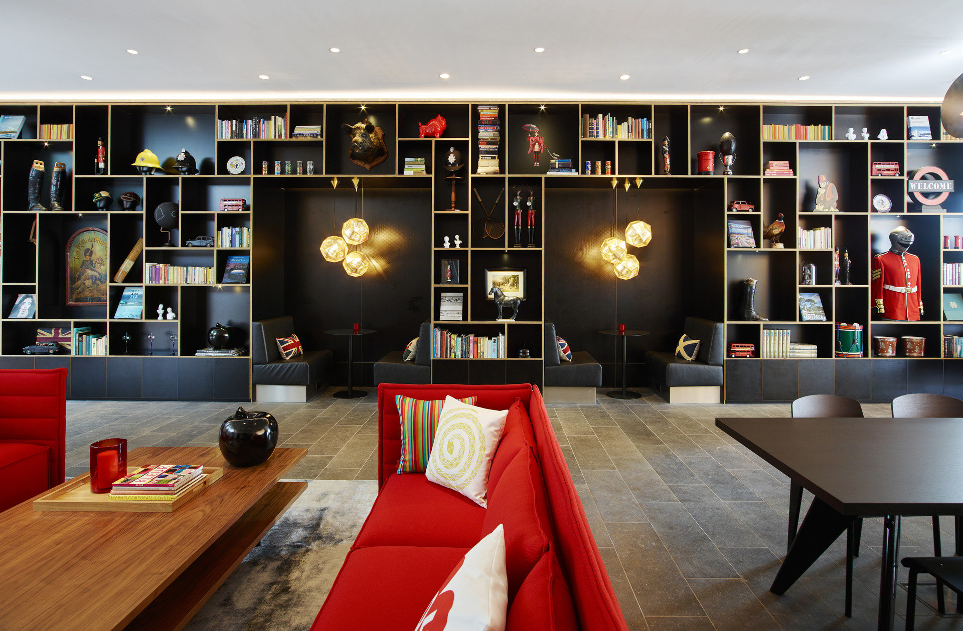 ambient lighting art artistic artsy books Boutique charming cozy decor Hip homey Hotels interior library living area living room Lounge lounge chairs Luxury quirky Style + Design stylish trendy indoor floor room ceiling interior design Design furniture Modern