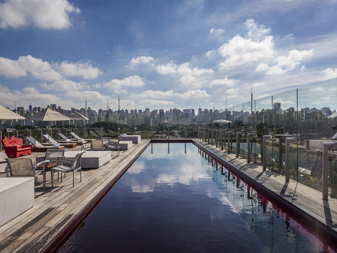 Hotels sky outdoor waterway water reflection residential area real estate City daytime cloud marina condominium building tree dock roof long day several