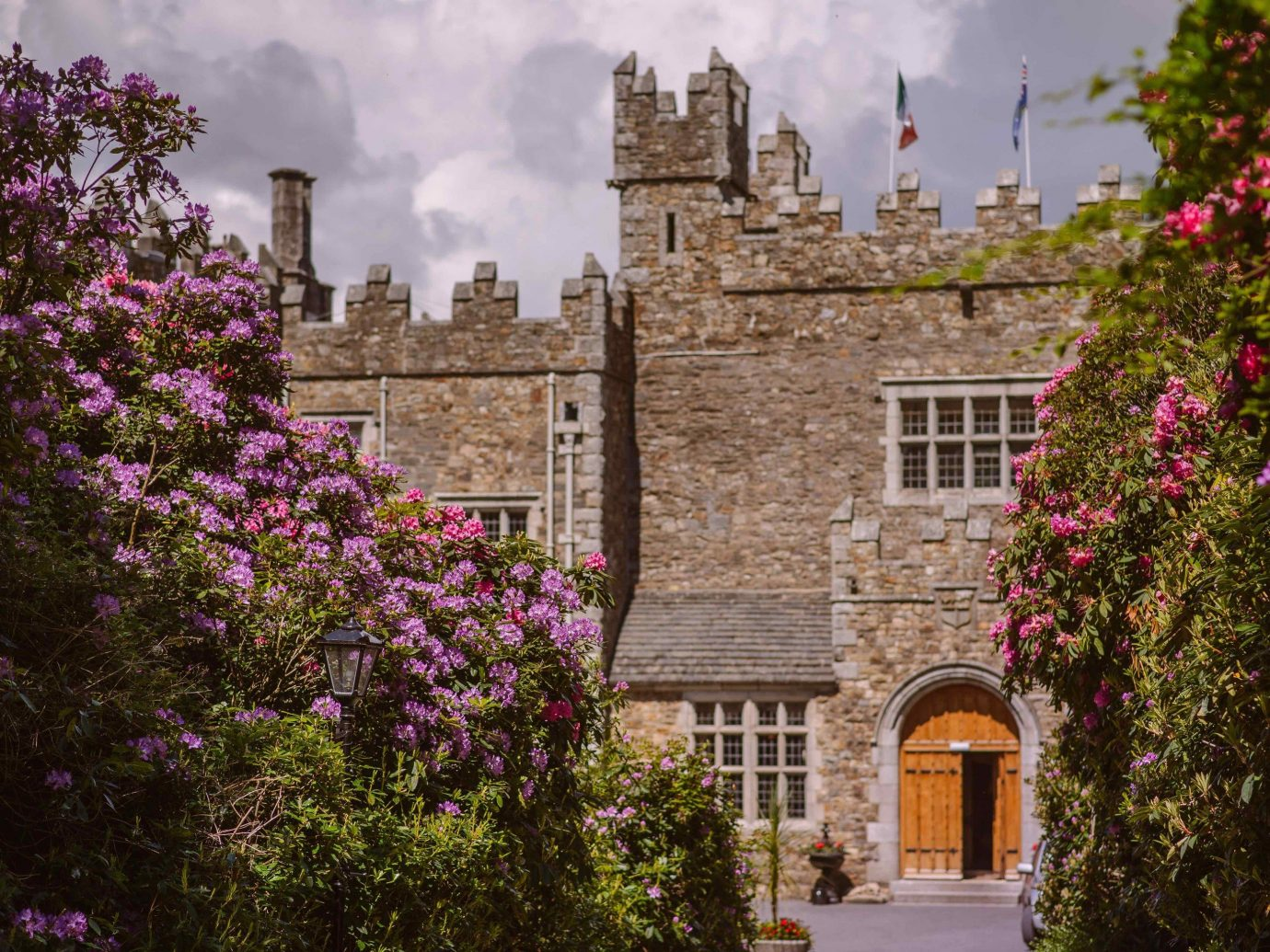 Hotels tree outdoor building sky flower City estate tourism château Garden old palace castle Courtyard stone surrounded crowd castle hotel Ireland