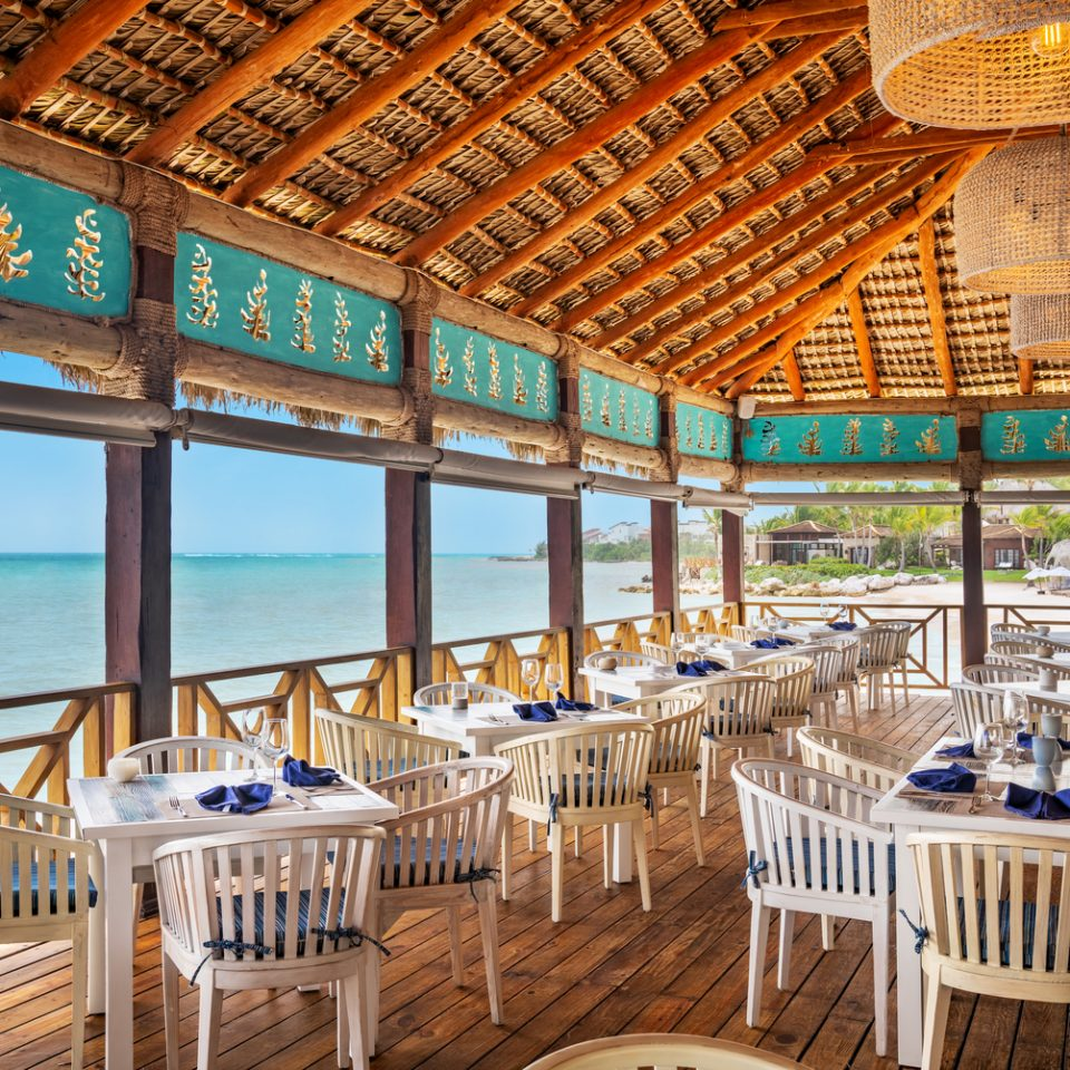restaurant with open walls looking over blue waters