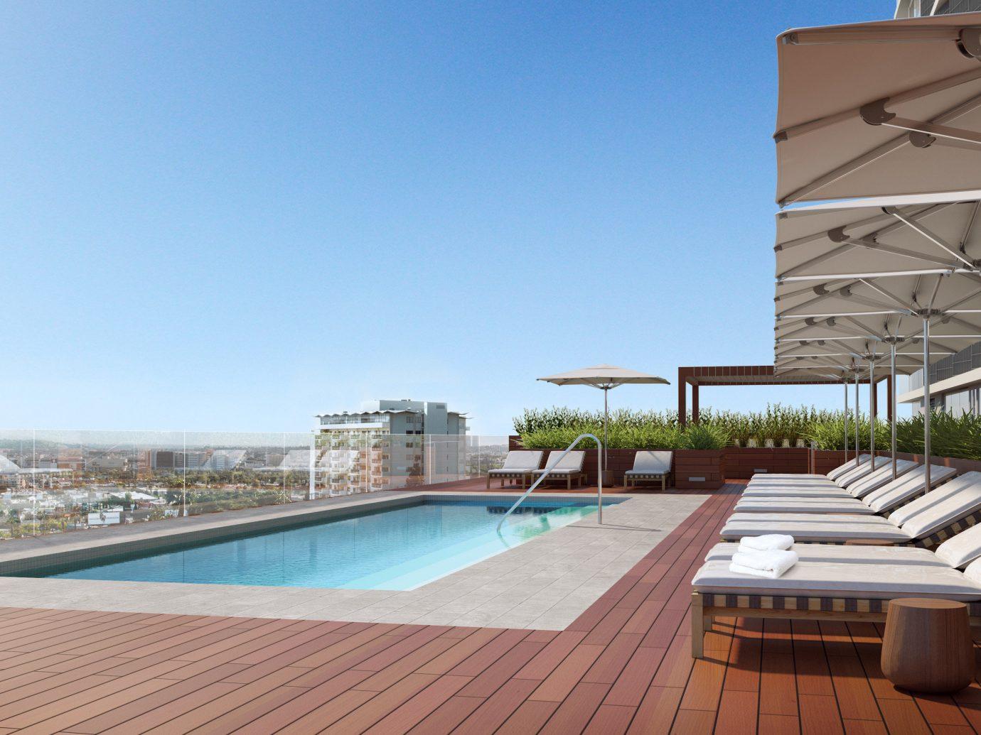 Hotels sky outdoor swimming pool property leisure building condominium real estate Villa estate outdoor structure Resort apartment