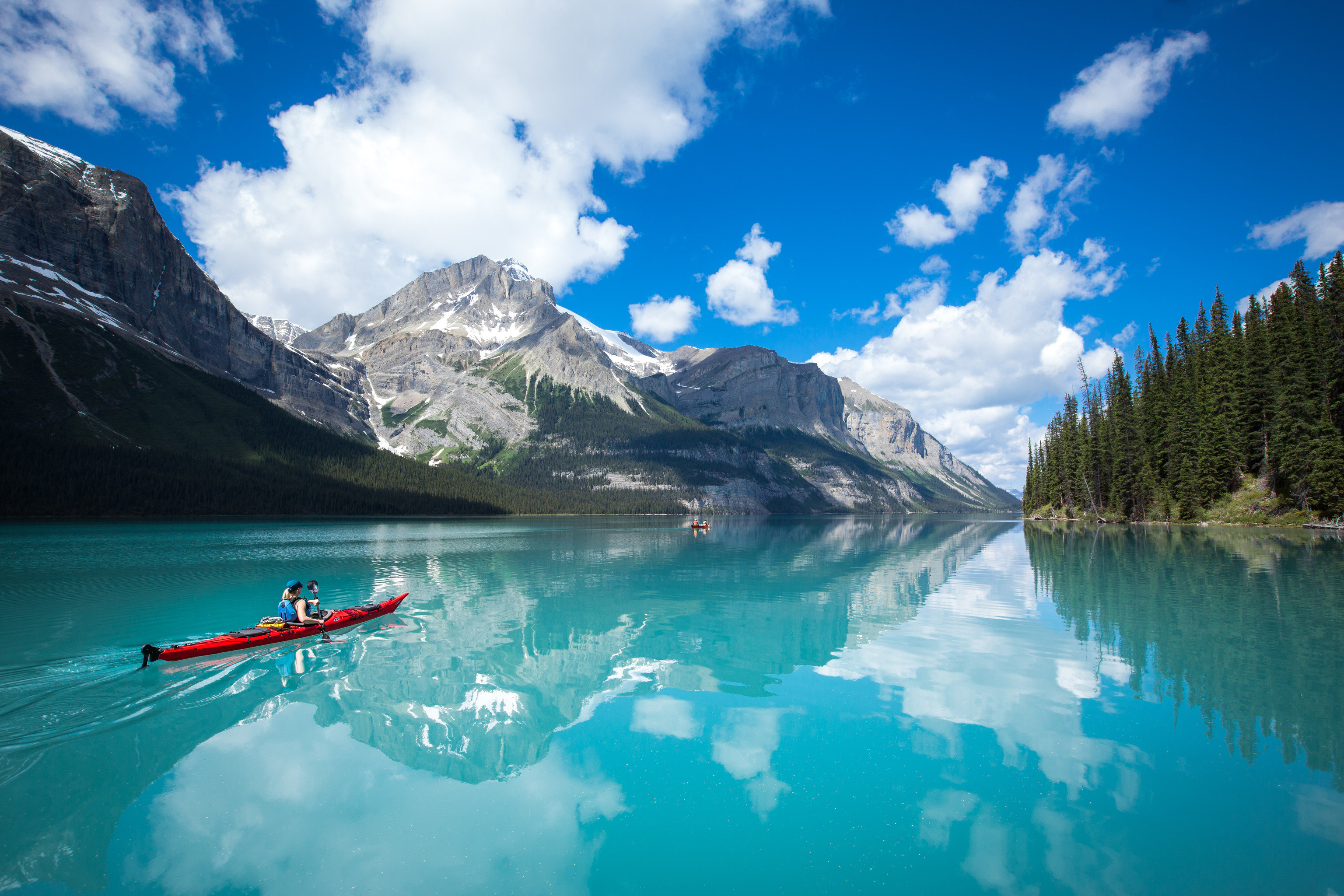 Mountains + Skiing National Parks Outdoors + Adventure Trip Ideas Weekend Getaways sky water mountain mountainous landforms outdoor Nature Lake mountain range reflection water sport fjord loch vehicle boating alps glacial landform swimming
