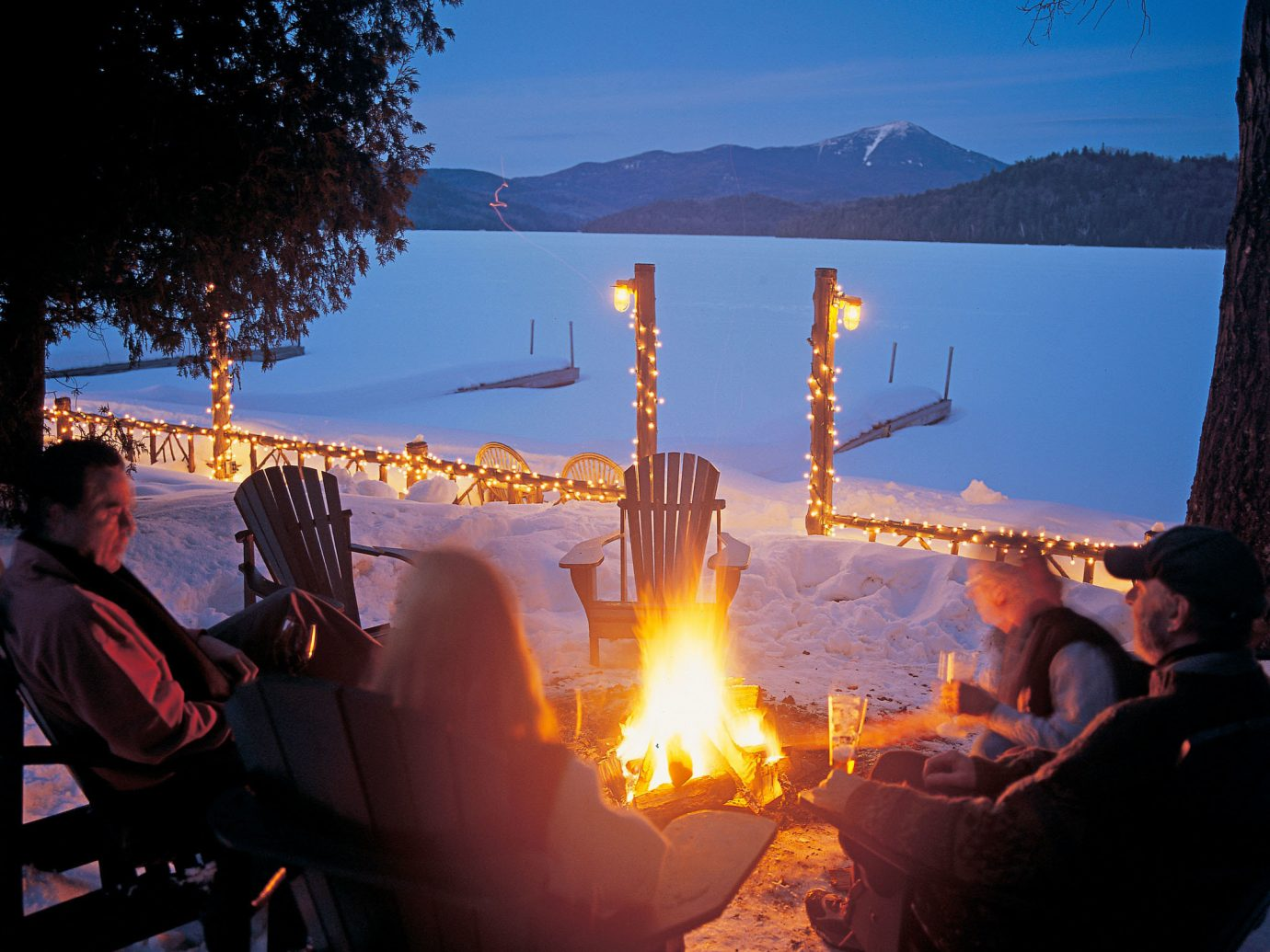 alpine skiing East Coast USA Firepit Hotels Lake Lodge Nature New York Outdoor Activities Romantic Hotels Rustic Trip Ideas Waterfront sky outdoor person light evening candle morning lit Sunset bonfire
