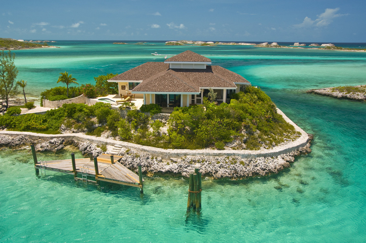 Hotels water outdoor sky Sea landform geographical feature swimming pool house caribbean vacation Nature shore Beach Resort Ocean estate Coast bay Lagoon archipelago Island islet resort town cove tropics Pool cape cay atoll reef swimming several