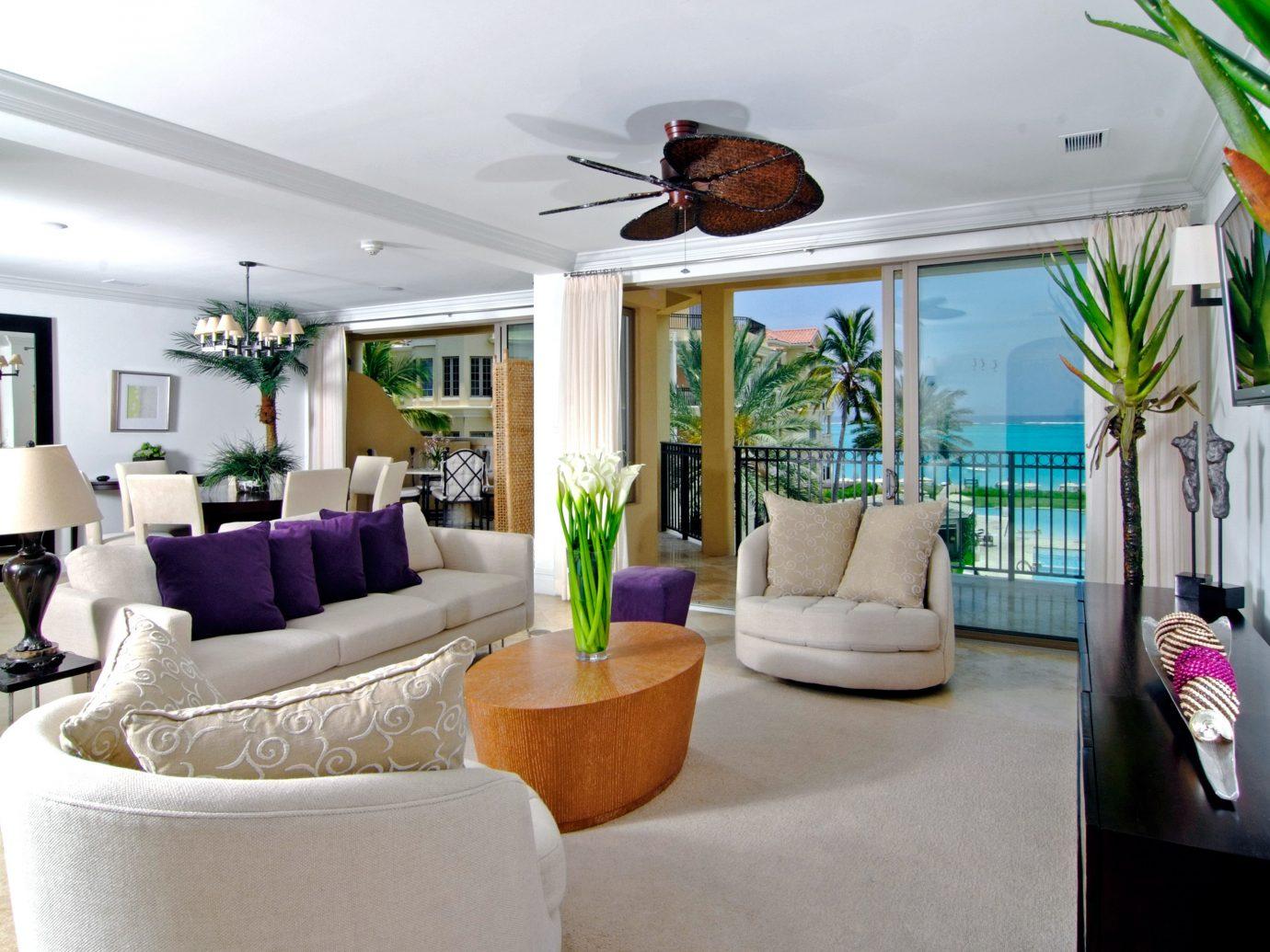 Beachfront Living Resort Trip Ideas indoor room property living room condominium ceiling home estate interior design real estate furniture Villa Suite cottage Design apartment mansion decorated area