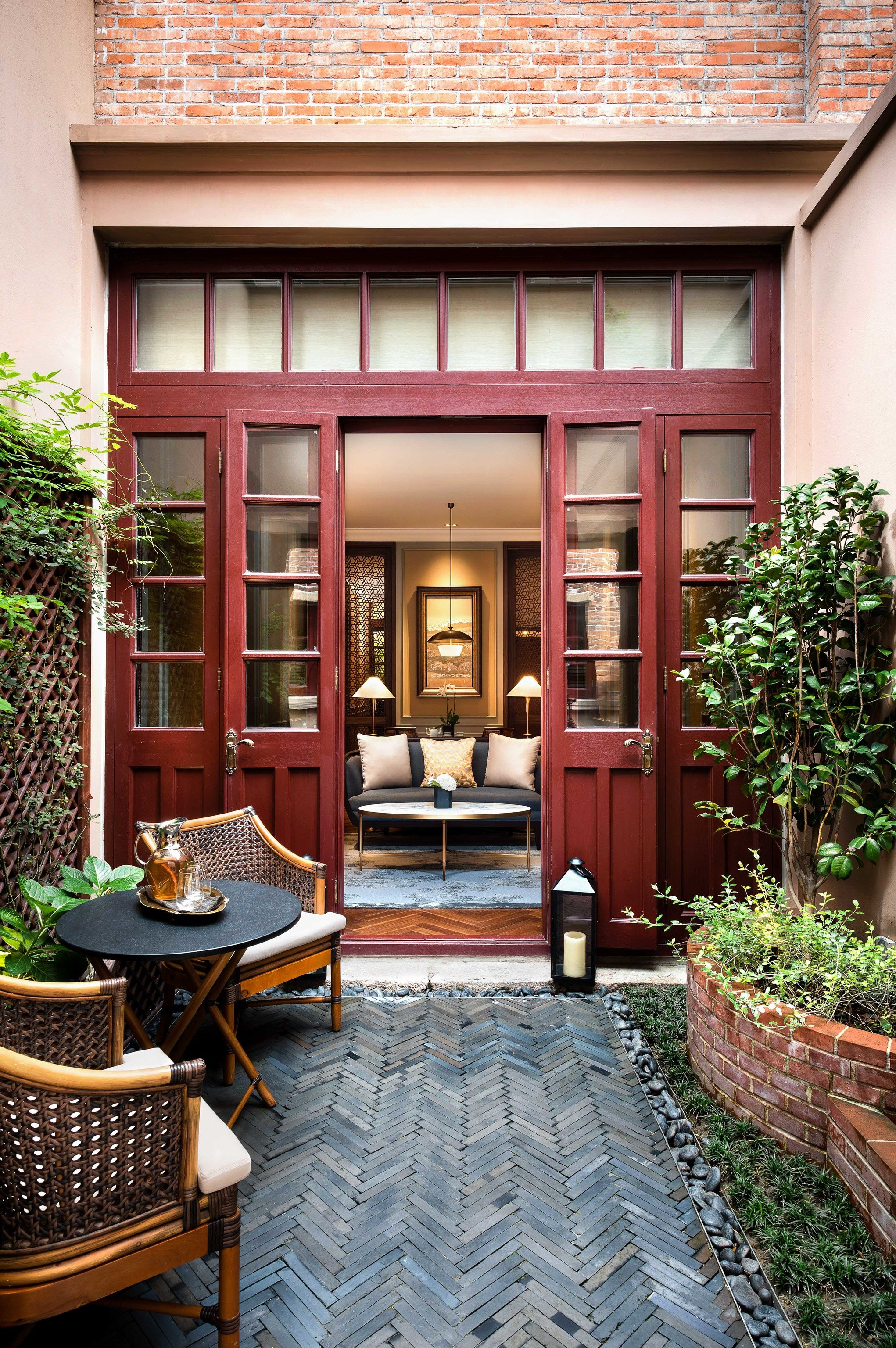 Boutique Hotels Luxury Travel outdoor ground building chair house home interior design Courtyard real estate facade window outdoor structure door Lobby estate Patio furniture stone