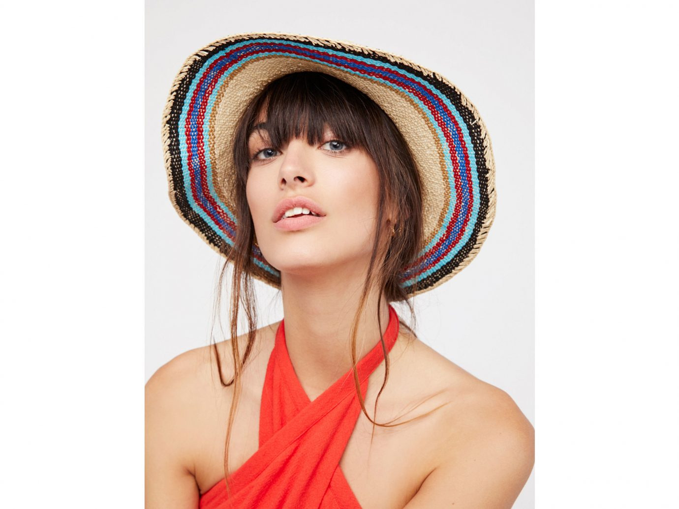 Cruise Travel Style + Design person hair clothing face wearing hairstyle fashion accessory long hair costume cap posing headgear hair accessory pattern veil dressed