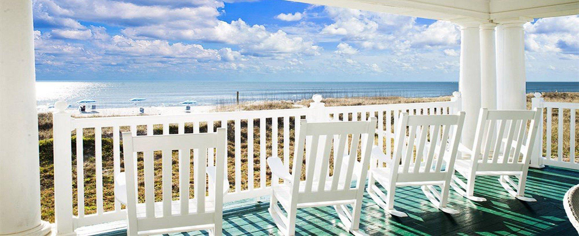 Hotels chair white property vacation estate caribbean Resort home Villa interior design porch cottage mansion Deck overlooking