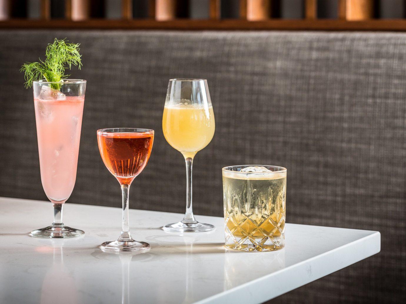 Arts + Culture table wine glass Drink alcoholic beverage cocktail restaurant distilled beverage beverage alcohol