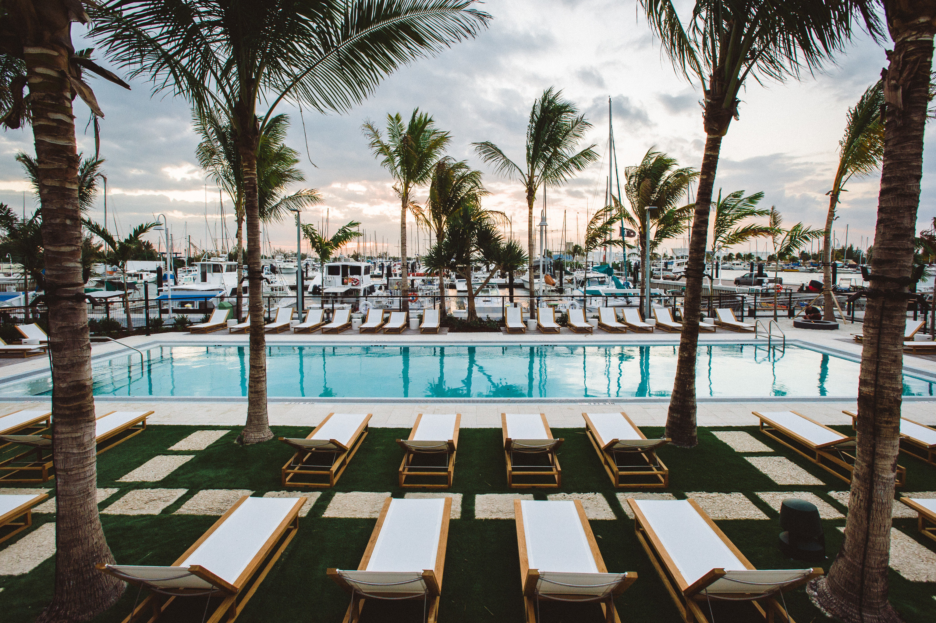 Florida Hotels Miami Romance Trip Ideas Weekend Getaways tree outdoor sky palm Resort water swimming pool palm tree arecales leisure plant Pool vacation hotel resort town tourism condominium recreation lined area shade furniture surrounded