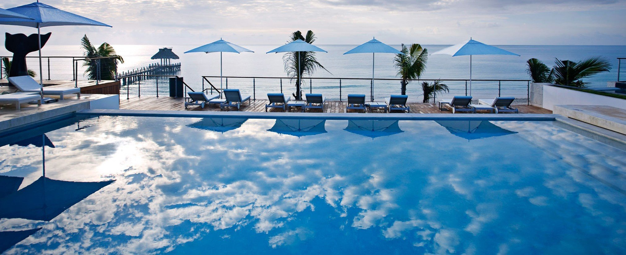 Hotels sky outdoor swimming pool blue leisure Resort vacation Nature estate Villa day clouds shore