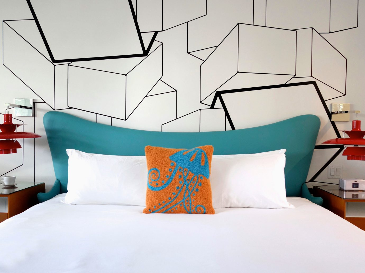 Trip Ideas indoor bed wall room bed sheet duvet cover furniture orange Design interior design pillow textile hotel Bedroom lamp