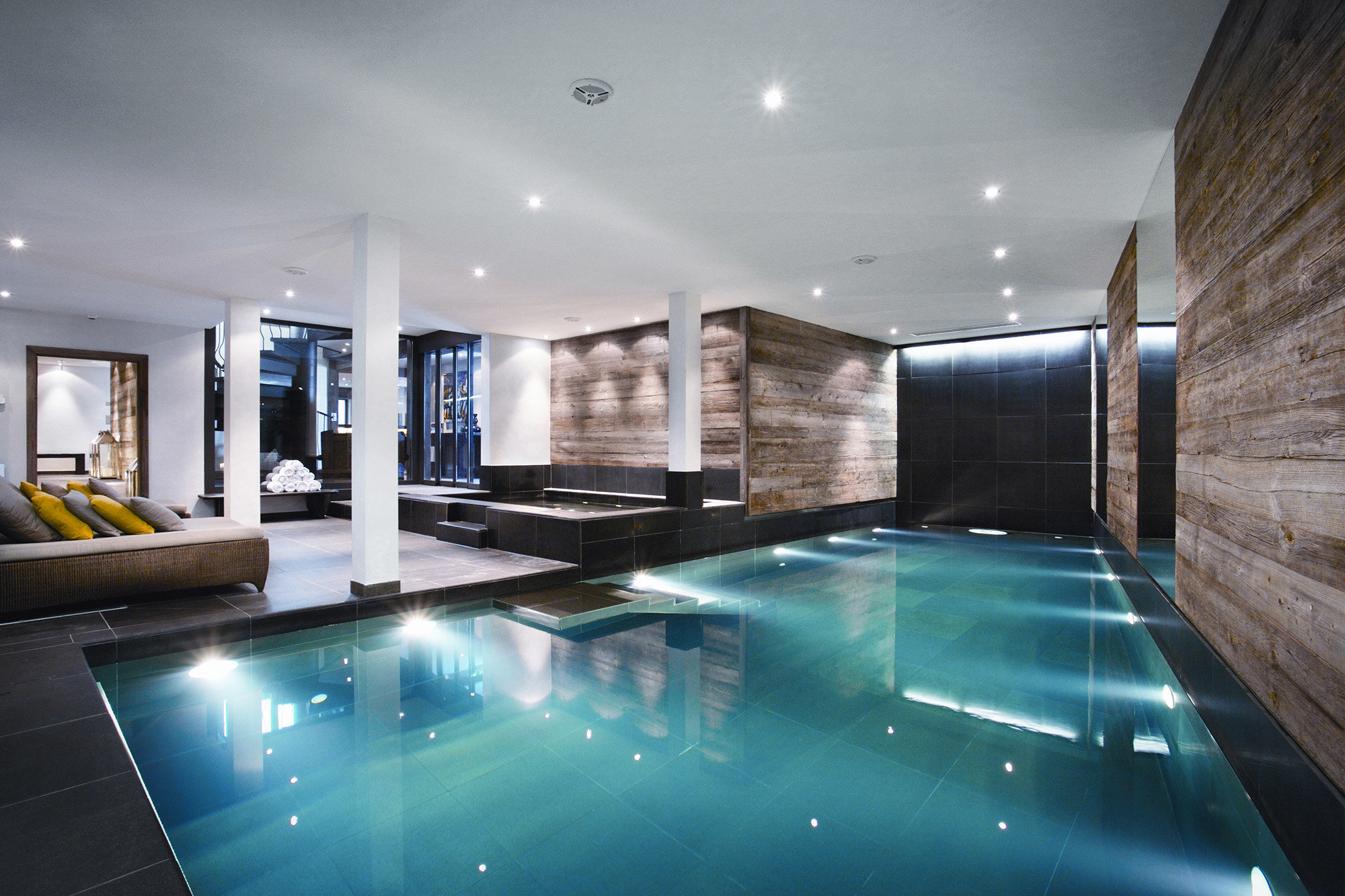 Hotels Luxury Travel Mountains + Skiing indoor ceiling wall floor swimming pool property room estate condominium interior design real estate mansion jacuzzi