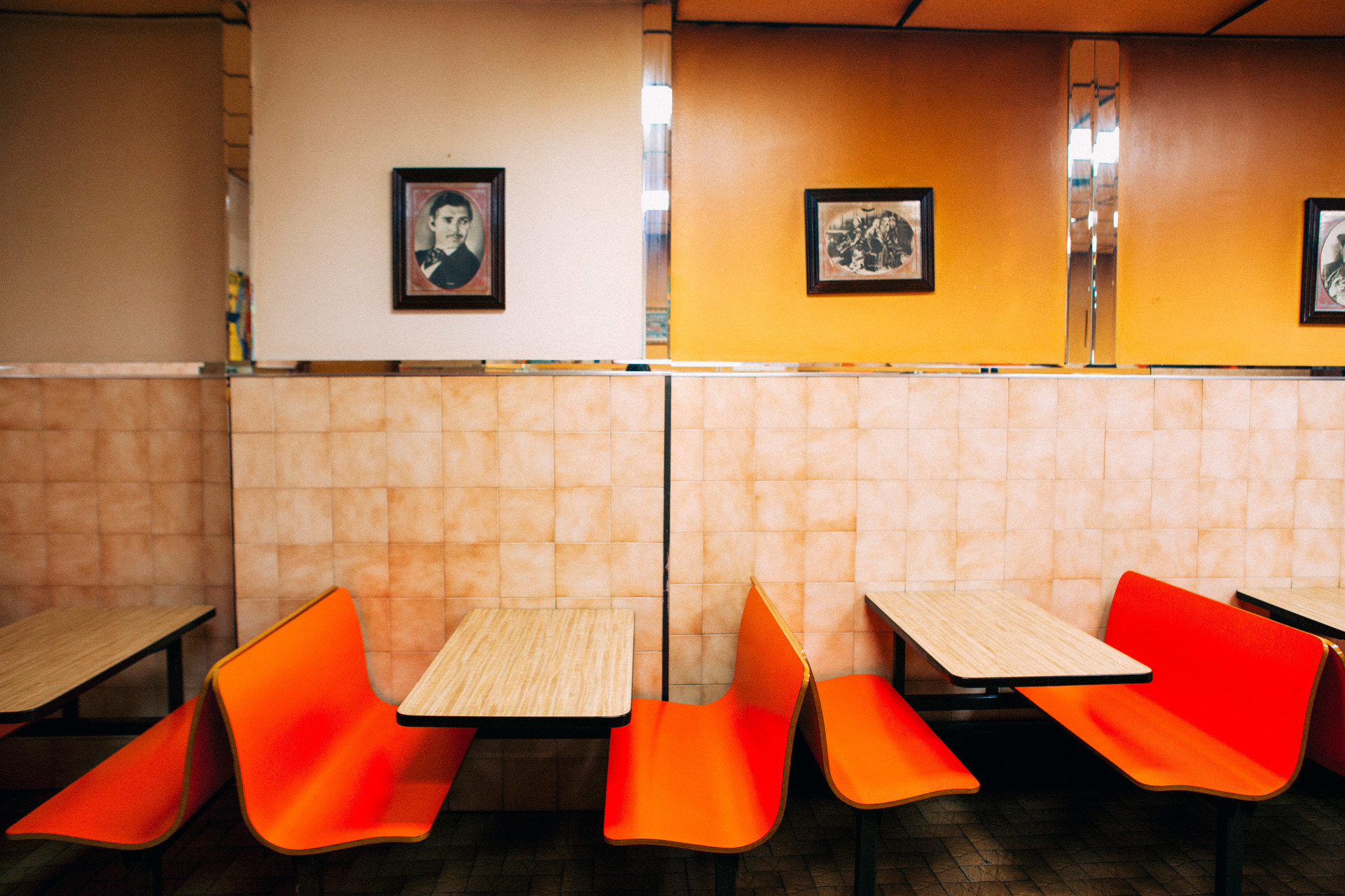 Food + Drink indoor wall floor color red orange room yellow interior design art Design restaurant furniture colored