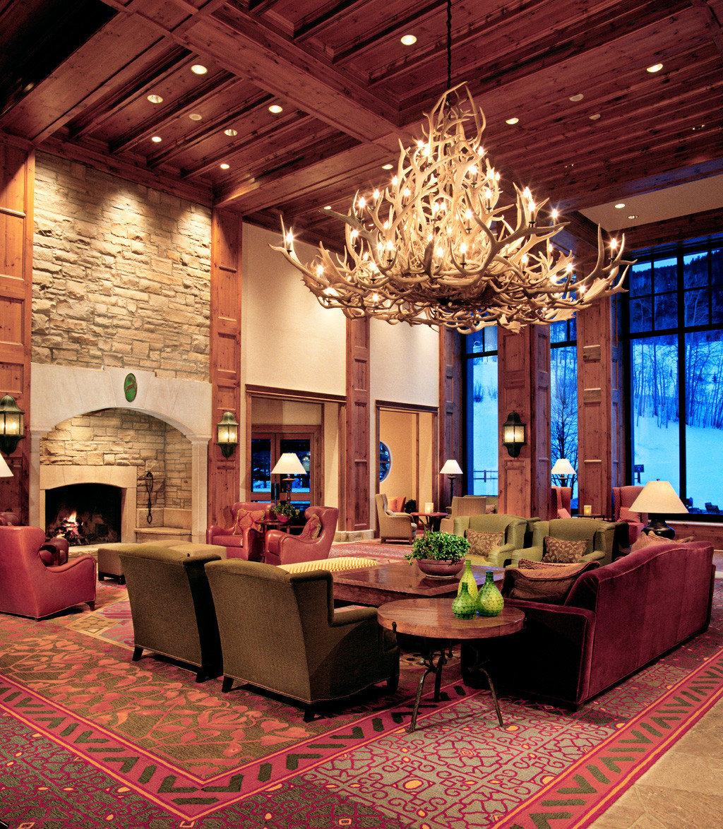 Hotels Luxury Travel Mountains + Skiing indoor ceiling floor Lobby room living room estate Living home interior design mansion Design restaurant furniture area several