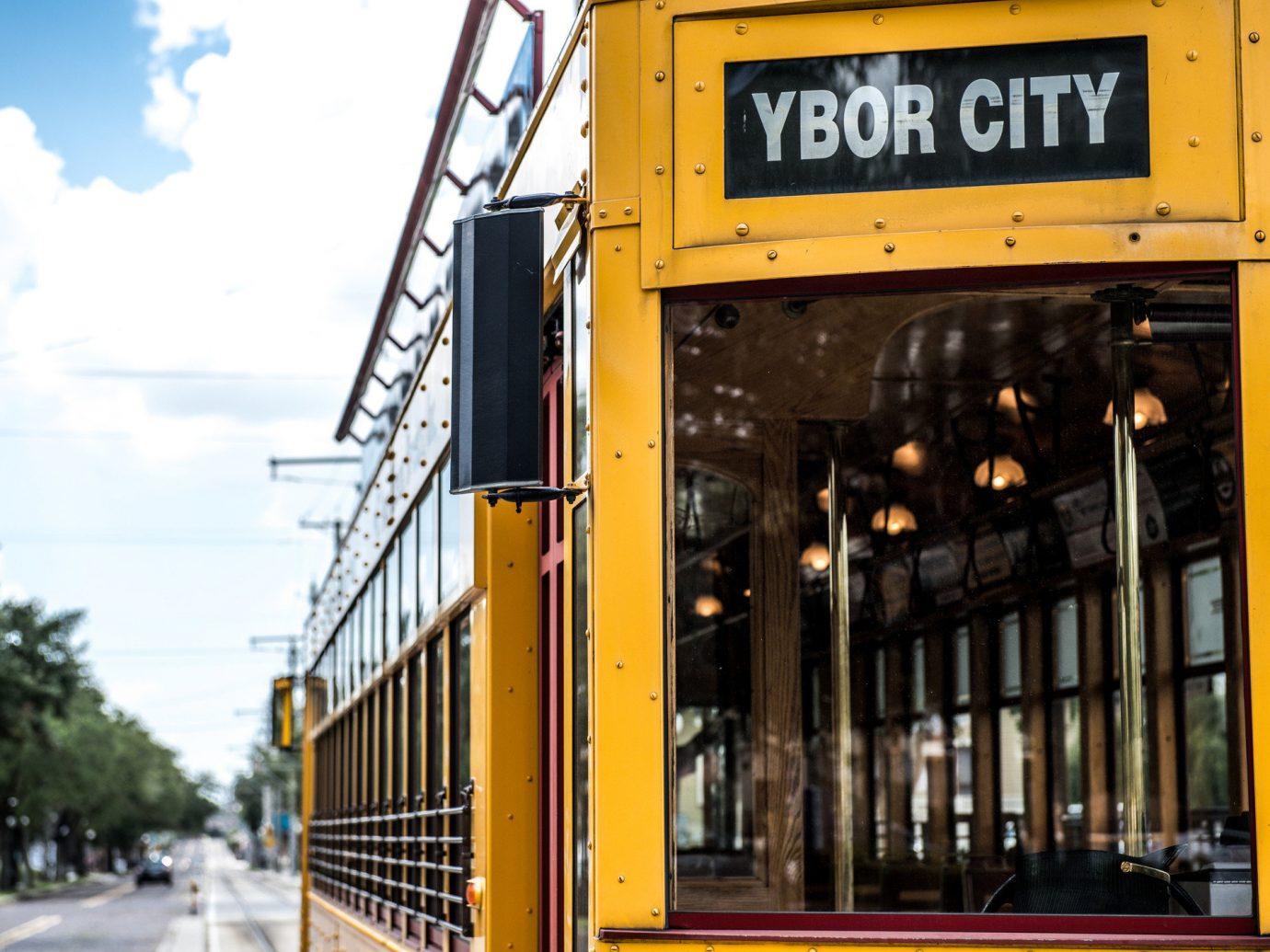 Trip Ideas outdoor sky yellow transport vehicle rolling stock public transport train bus tram railroad car