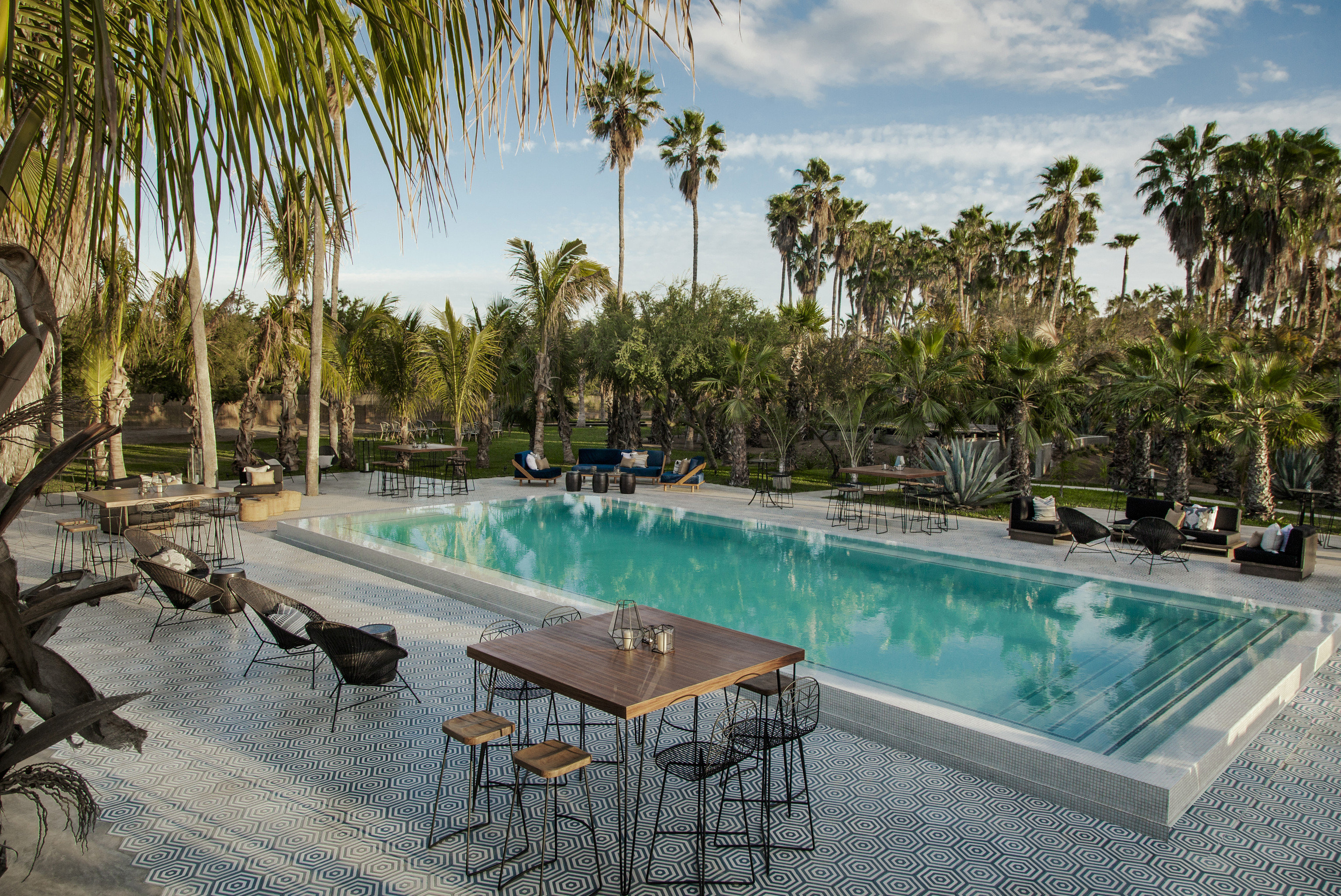 Trip Ideas tree outdoor leisure swimming pool property chair Resort estate vacation Villa Pool real estate palm condominium palace plant area furniture sandy several