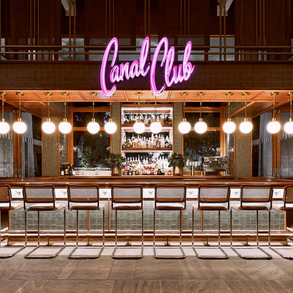 Canal Club neon pink sign above bar at The Scott Resort & Spa