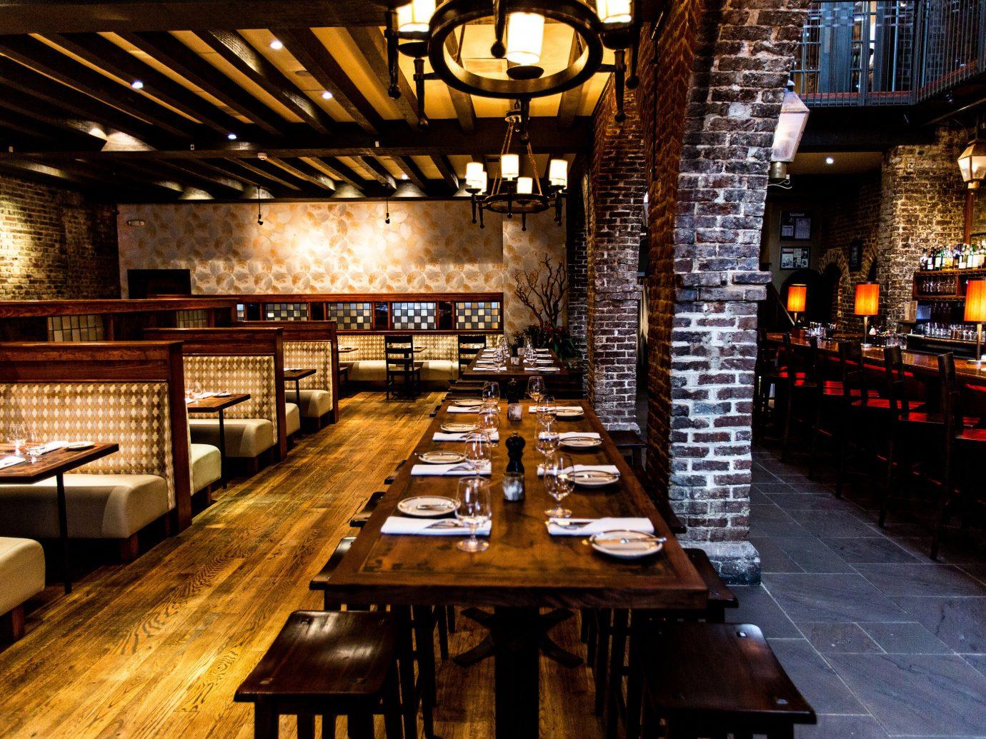 Food + Drink table indoor floor restaurant Bar wooden interior design estate long wood furniture dining room