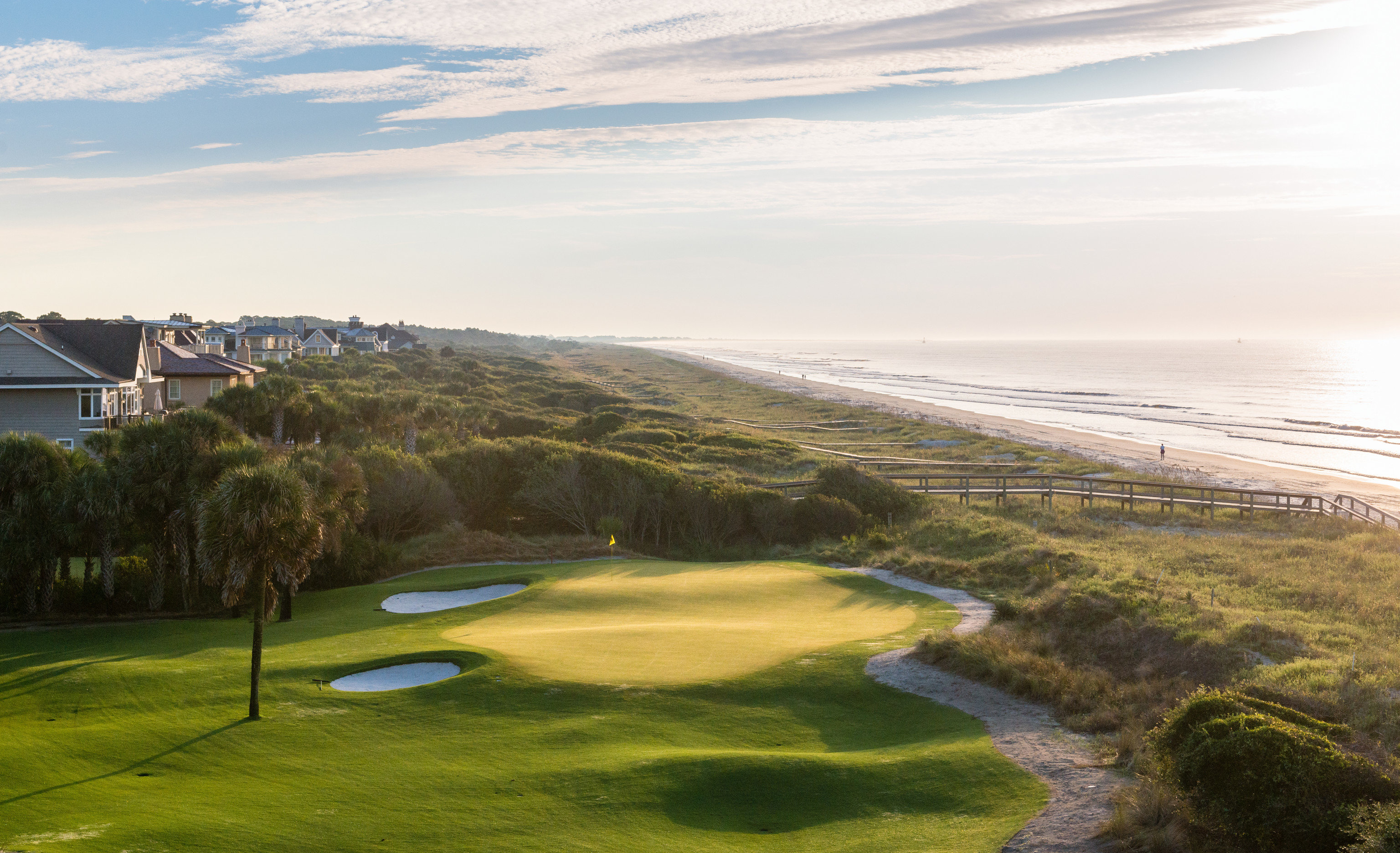 Beach East Coast USA Trip Ideas grass outdoor sky structure sport venue Nature Coast golf course sports Sea golf club grassy lush overlooking hillside