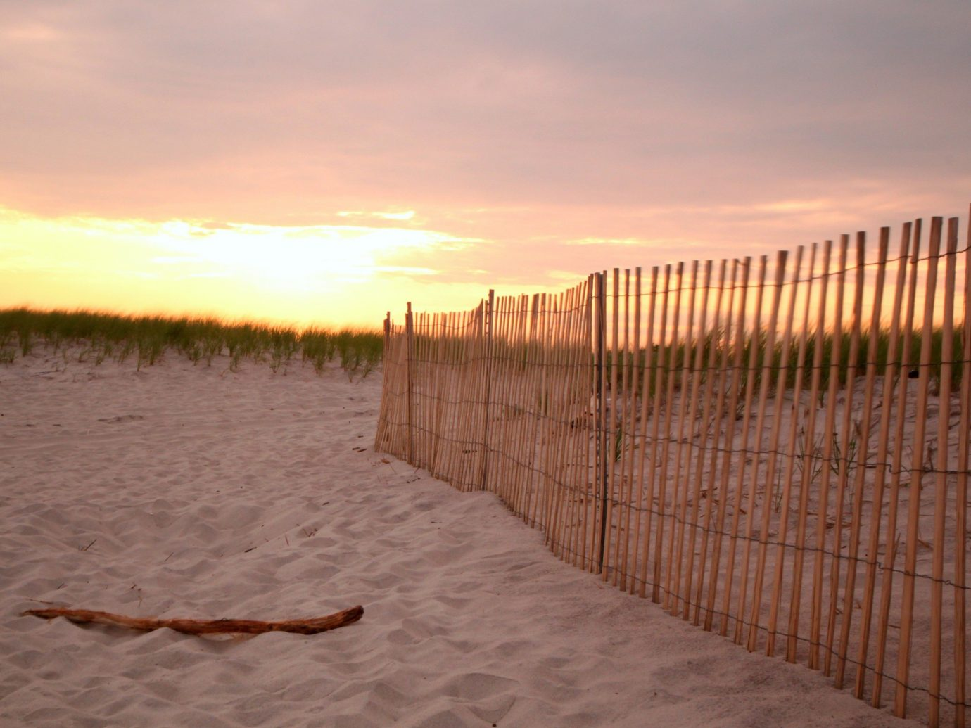 Trip Ideas sky outdoor Sunset morning Beach sunlight Sea wood walkway sand Fence outdoor structure sunrise