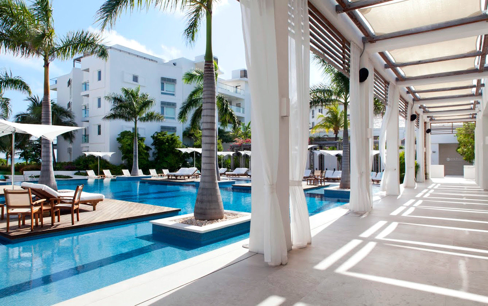 Beachfront Grounds Hotels Play Pool Resort Trip Ideas building outdoor property leisure condominium swimming pool estate vacation Villa real estate home mansion plaza apartment furniture colonnade