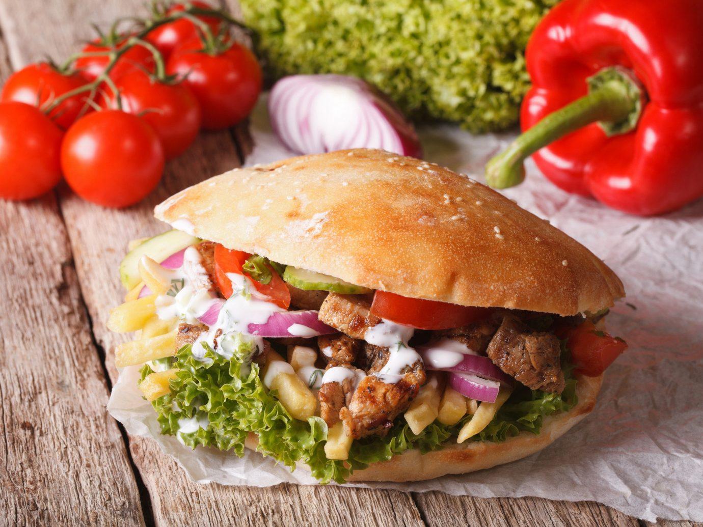 Food + Drink food dish sandwich veggie burger meat cuisine tomato snack food meal produce vegetable fresh