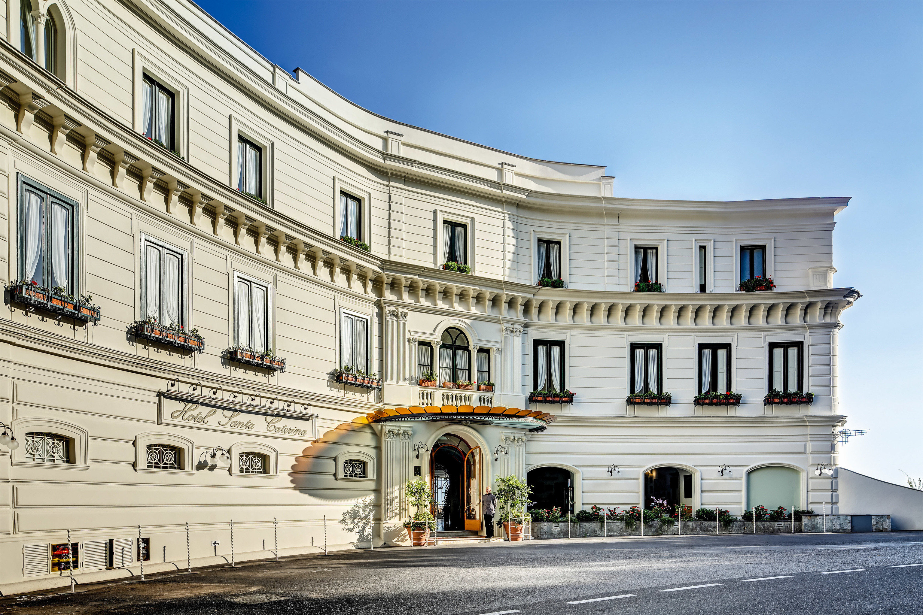 Hotels Romance sky outdoor building classical architecture landmark Architecture palace facade window plaza white real estate estate château town square tourism apartment mansion City government building