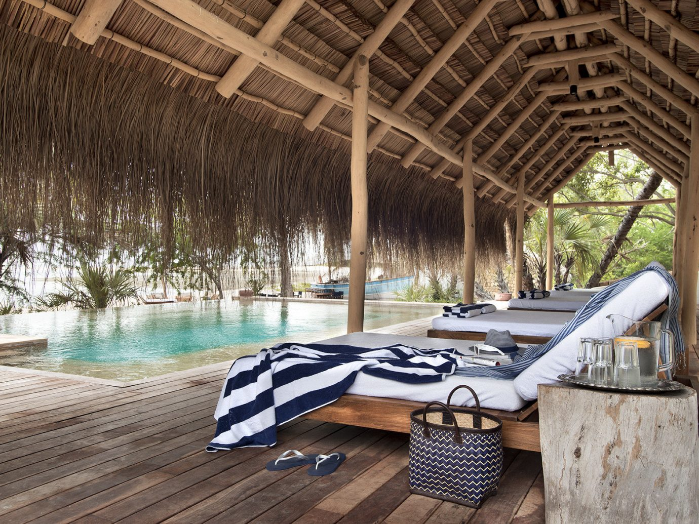 Trip Ideas outdoor house estate wood swimming pool home backyard interior design outdoor structure Resort cottage