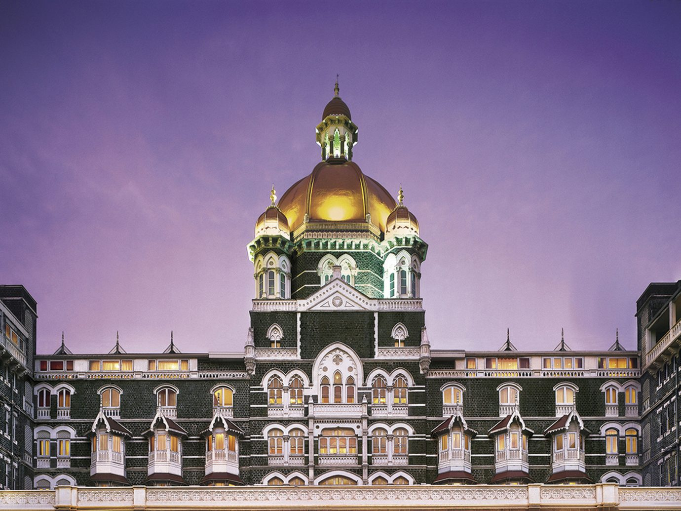 Hotels Luxury Travel building sky outdoor landmark tourist attraction metropolis château City palace facade town square metropolitan area night monument tourism dome symmetry clock tower historic site evening classical architecture tower seat of local government plaza