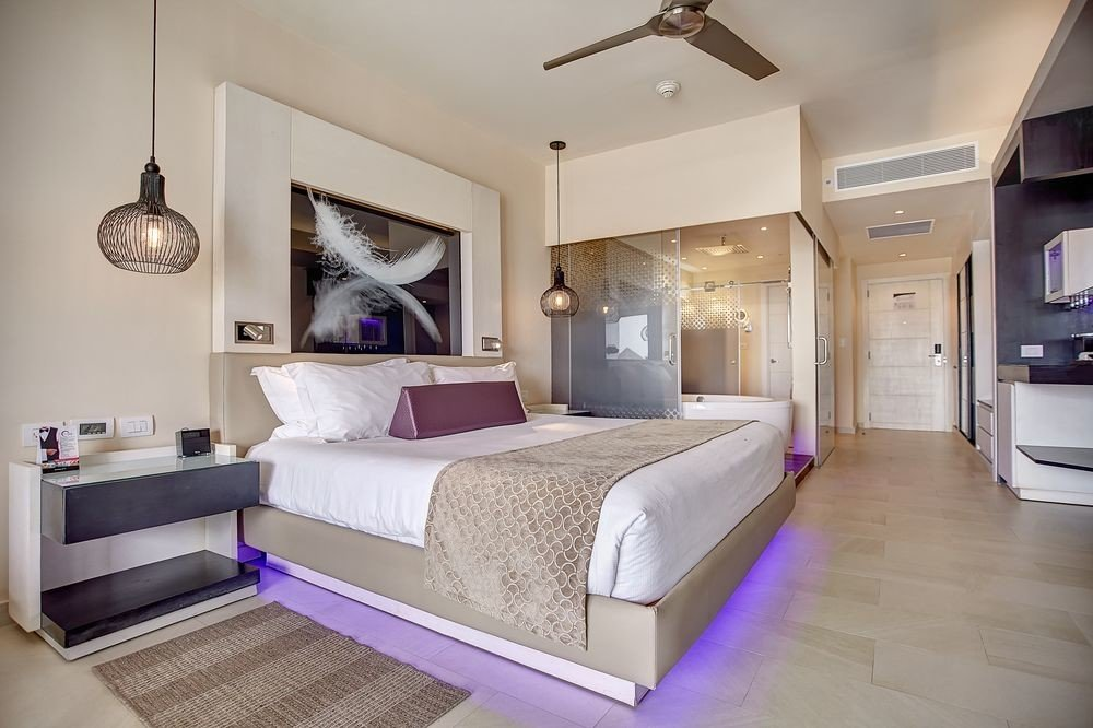 All-Inclusive Resorts Hotels Romance Solo Travel indoor floor wall room bed property interior design ceiling Suite Bedroom real estate estate hotel interior designer bed frame penthouse apartment area furniture