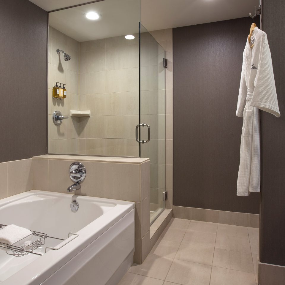 upgraded bathroom with bathtub and shower