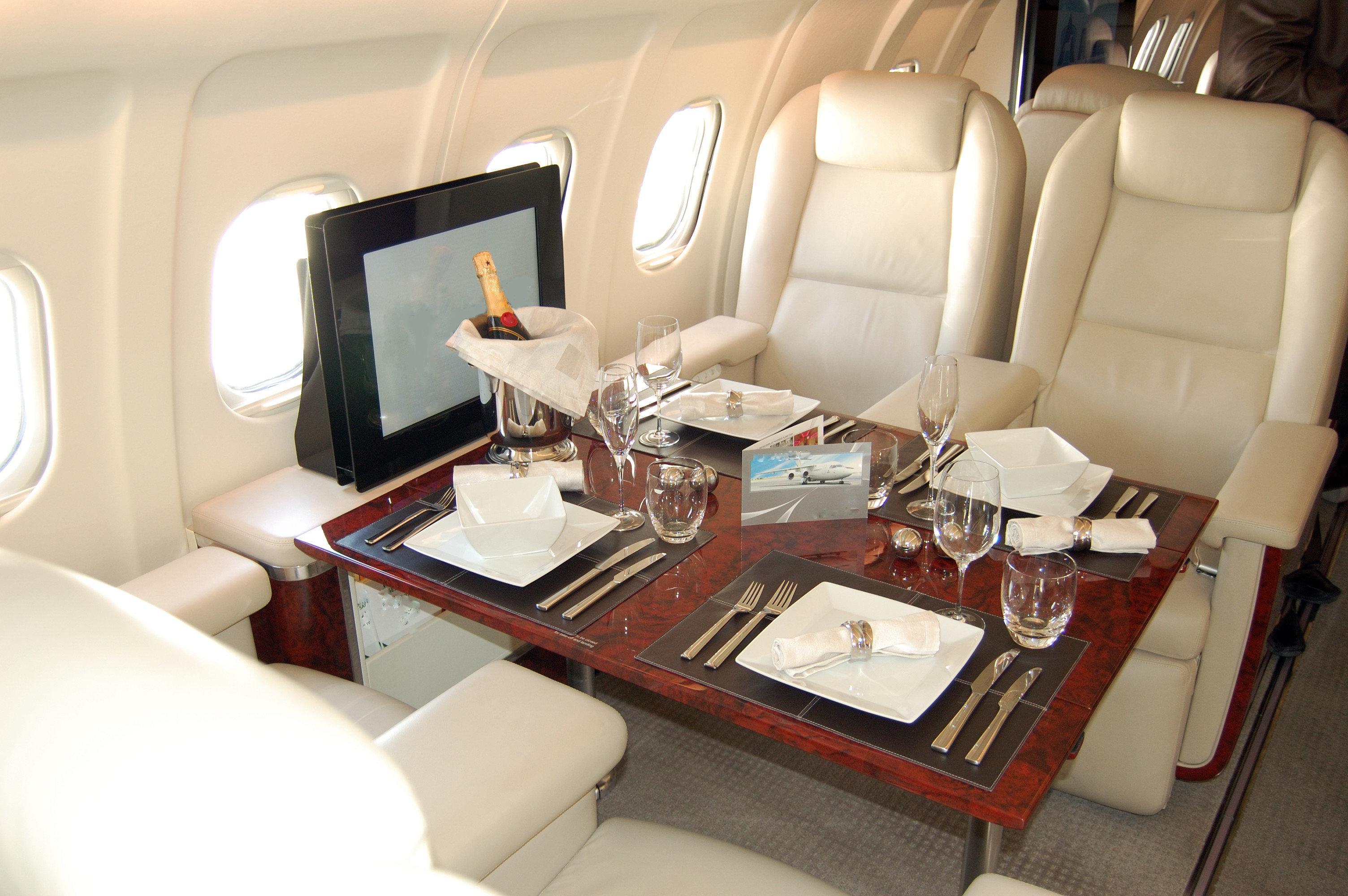 Flights Travel Tips indoor floor vehicle room Boat Cabin airline yacht Living passenger ship luxury yacht luxury vehicle interior design seat furniture