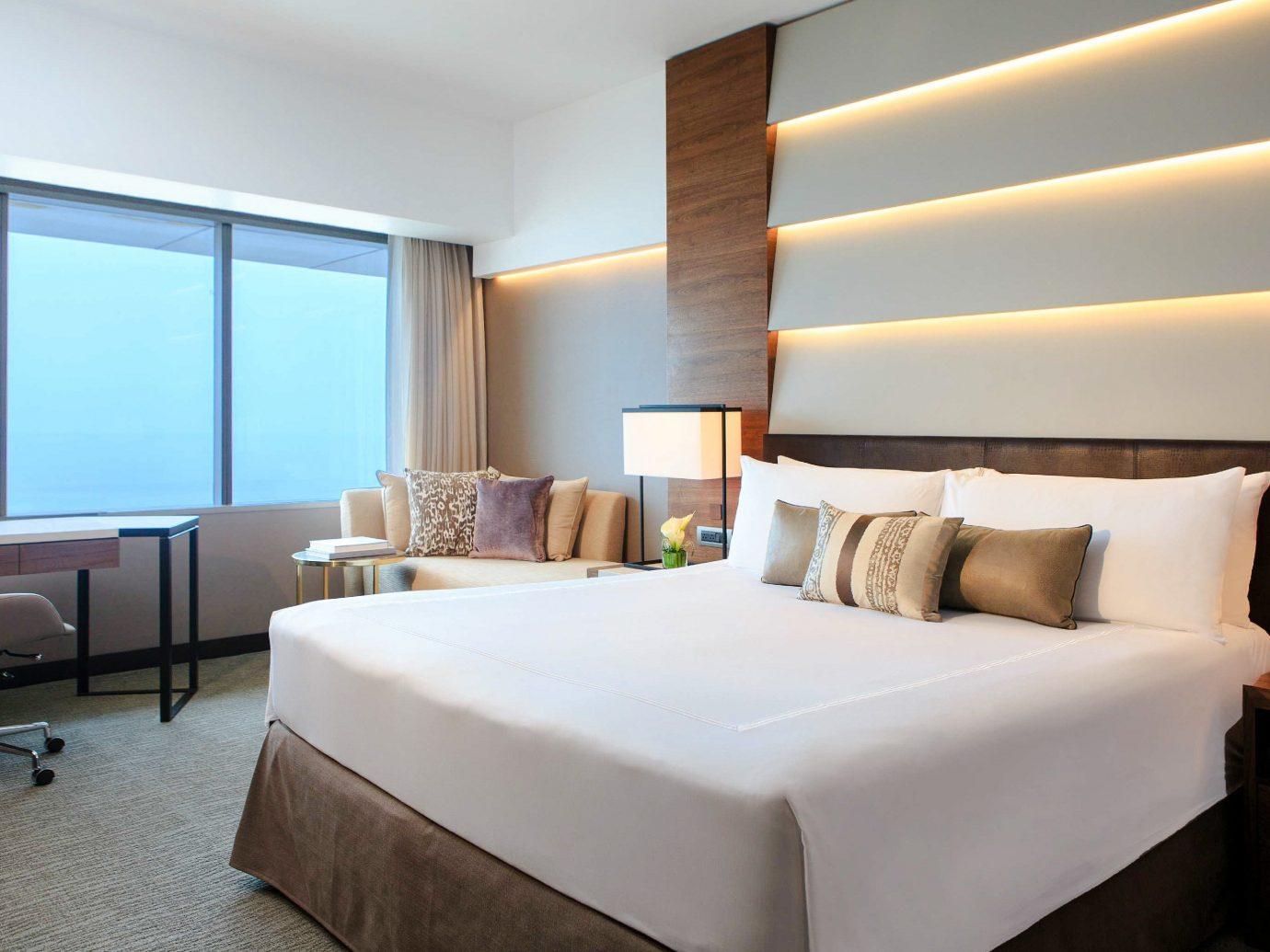 Boutique Hotels Hotels indoor bed floor wall hotel room ceiling Suite window interior design Bedroom bed frame real estate bed sheet window covering decorated furniture several