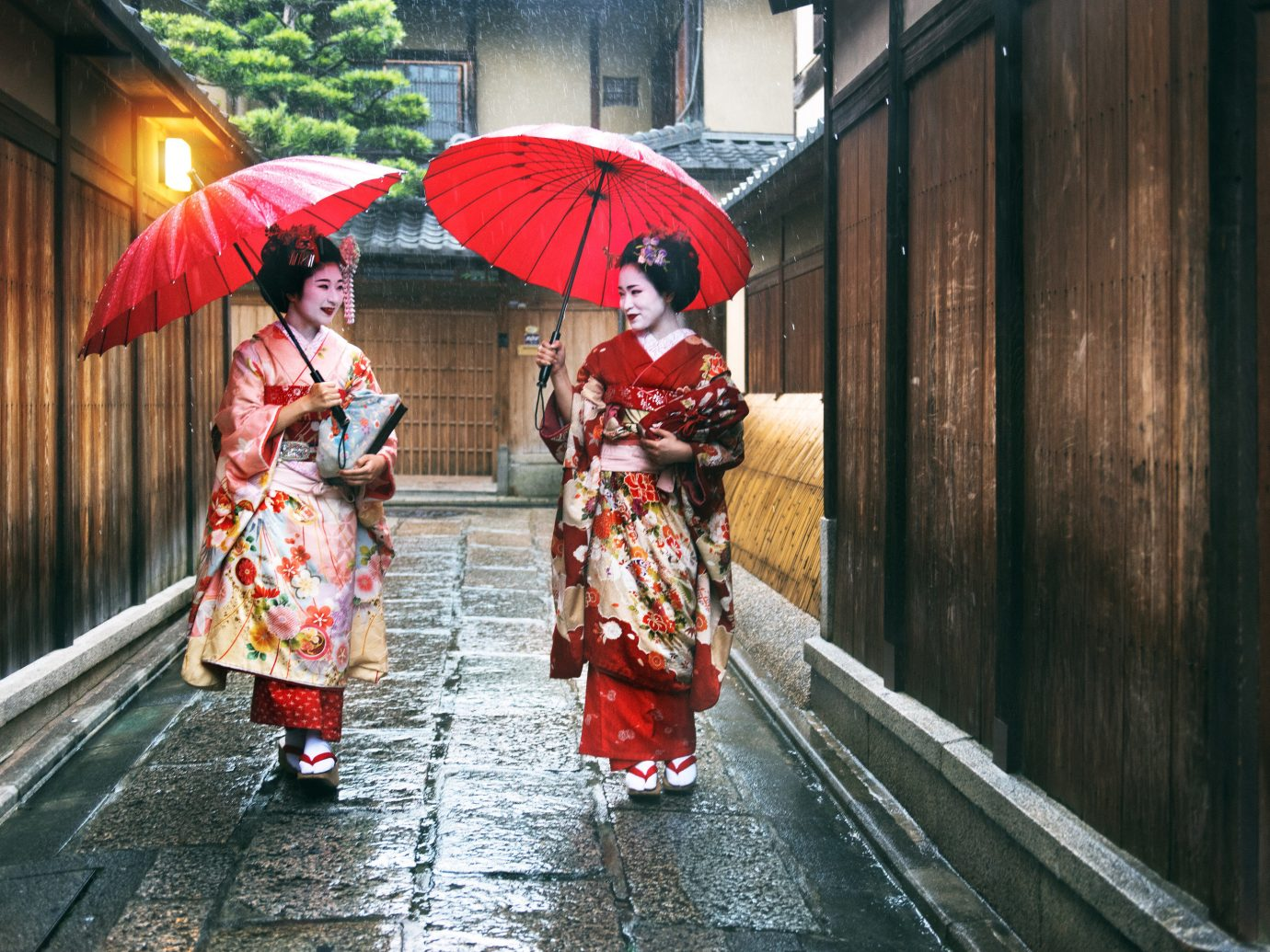 Jetsetter Guides umbrella outdoor color red clothing woman person rain walking street sidewalk Nature costume spring way accessory carrying tradition rainy
