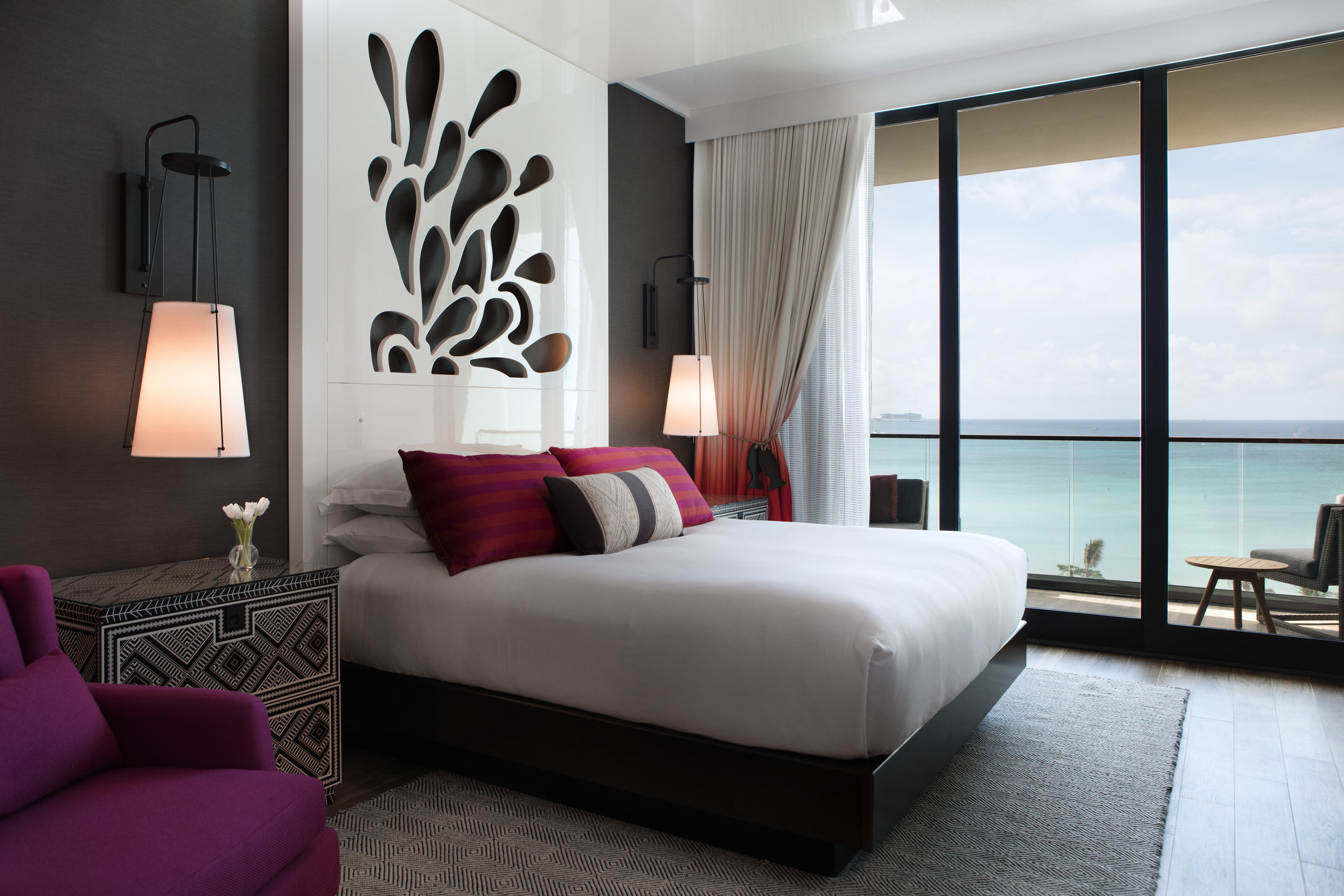 Hotels Trip Ideas indoor floor room sofa wall bed hotel window property Bedroom living room Suite interior design home nice furniture condominium real estate Design estate apartment area flat