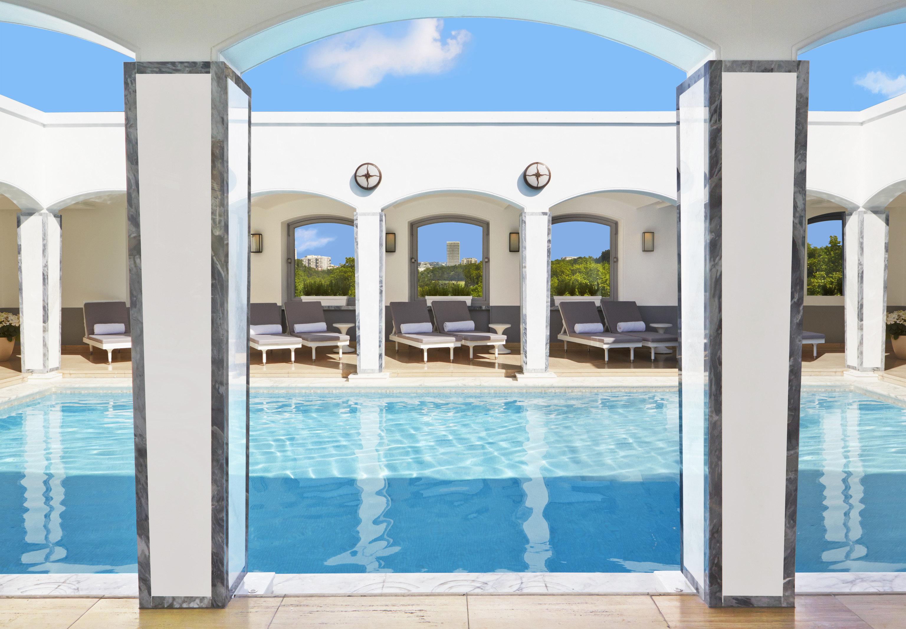 Hotels Luxury Travel swimming pool property building leisure centre estate condominium facade window interior design Resort Villa mansion blue colonnade