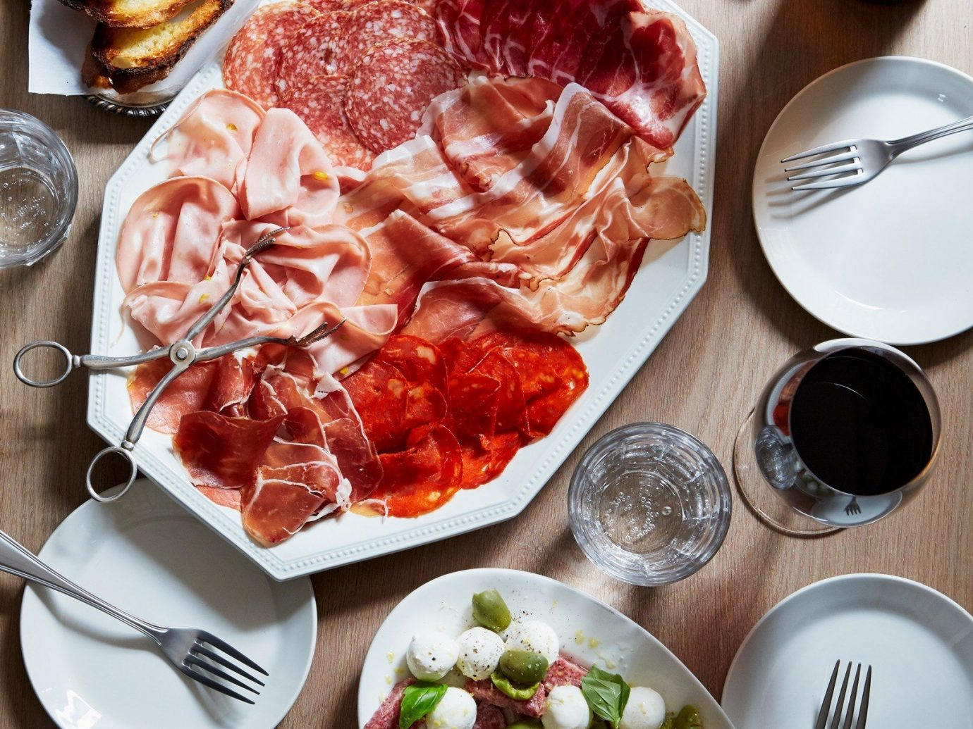 Food + Drink food plate table dish meal breakfast lunch brunch meat produce full breakfast cuisine hors d oeuvre salt cured meat several