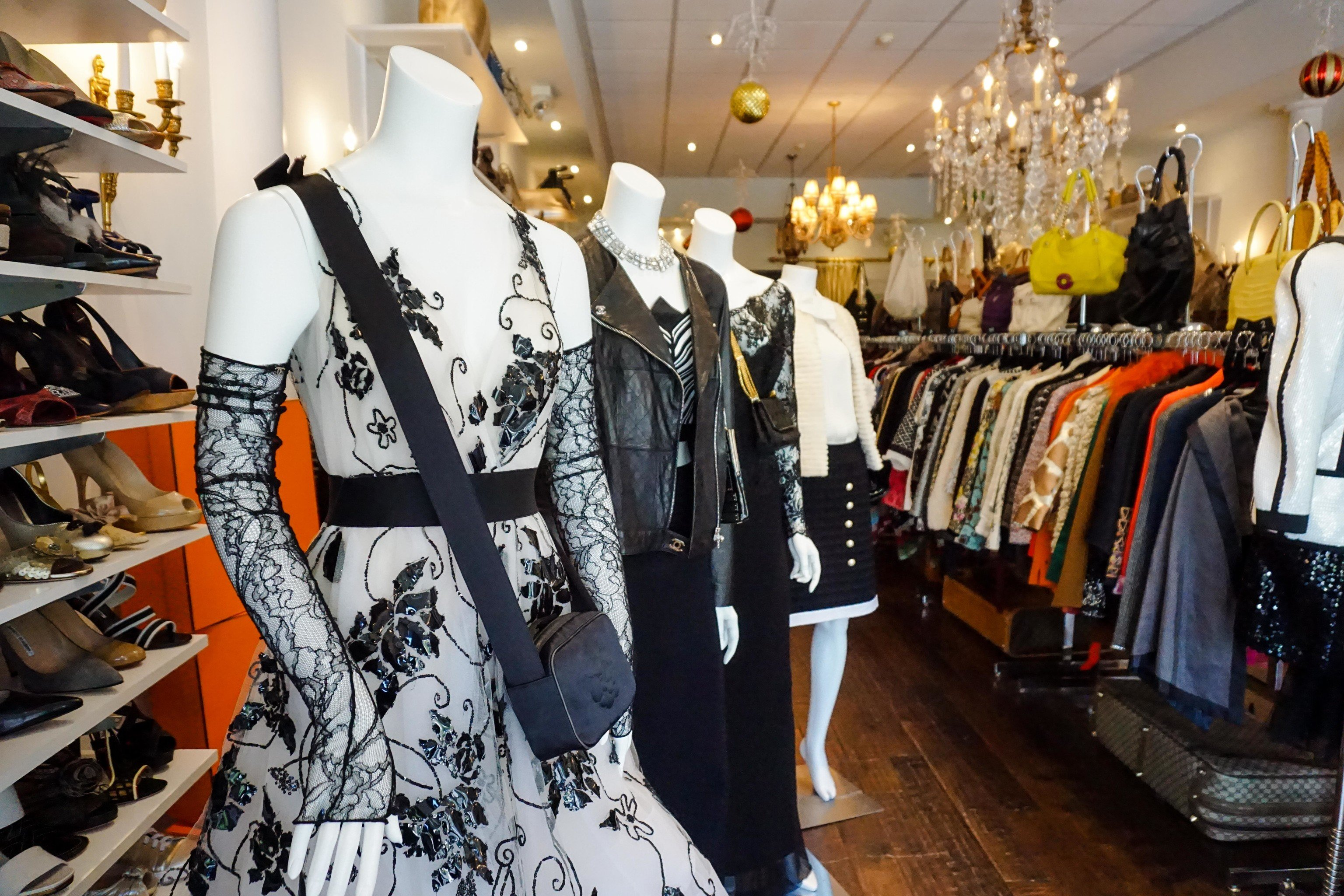 Travel Shop indoor wall Boutique retail fashion outerwear wardrobe stylist shopping buyer fashion design clothes several cluttered