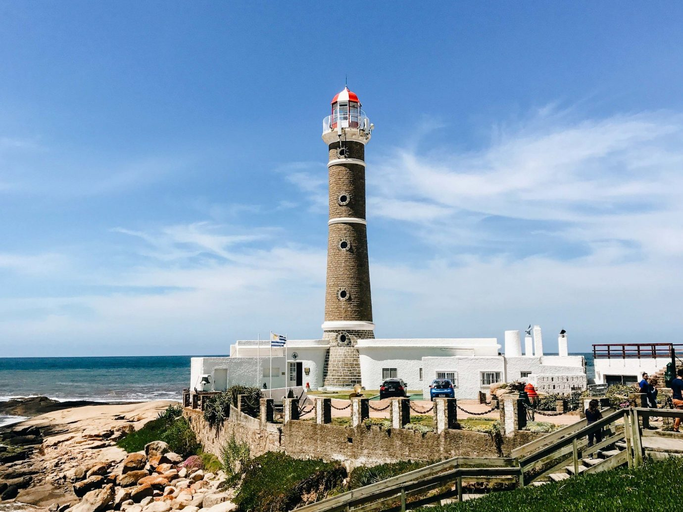 Beach Romantic Getaways south america Trip Ideas Uruguay lighthouse tower sky Sea Coast promontory beacon shore daytime cloud cape