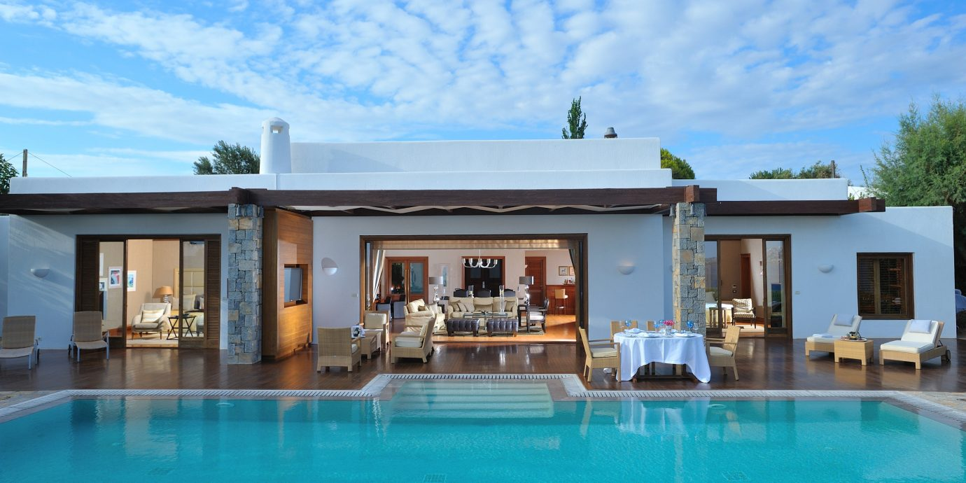 Hotels Luxury Travel swimming pool property leisure Pool estate building house Resort home Villa vacation real estate blue mansion cottage swimming