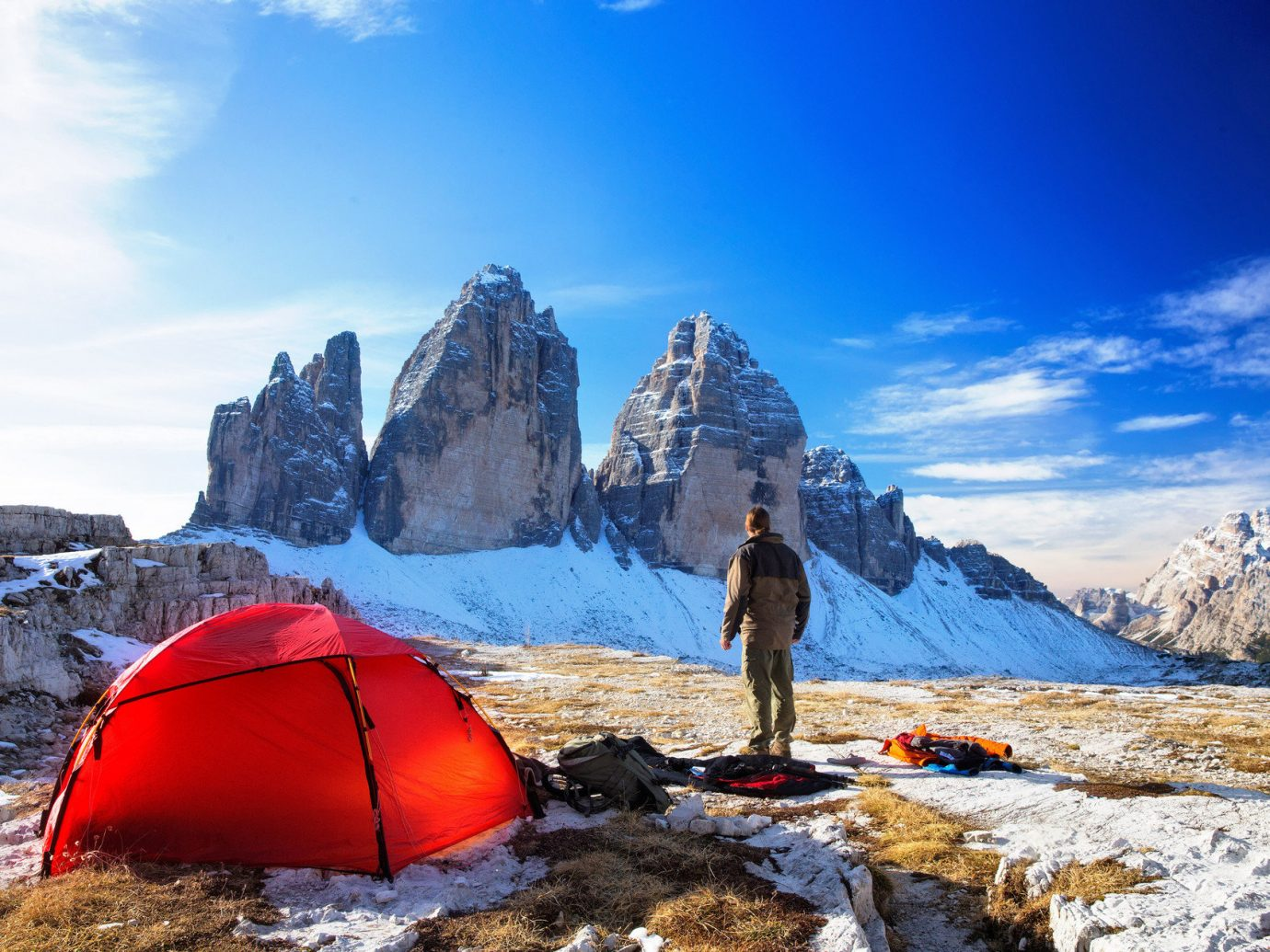 Offbeat outdoor sky snow mountainous landforms mountain umbrella wilderness mountain range Winter mountaineering season red Adventure outdoor recreation sports tent alps recreation plateau summit backpacking walking ridge accessory