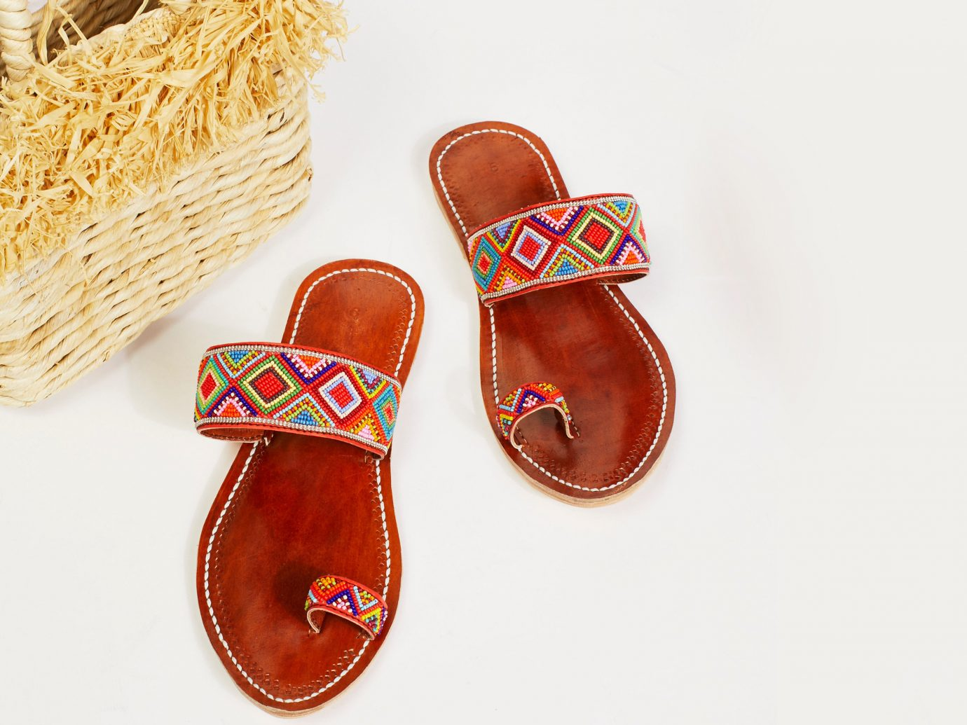 Hotels Style + Design Trip Ideas footwear shoe cloth sandal slipper outdoor shoe product flip flops font