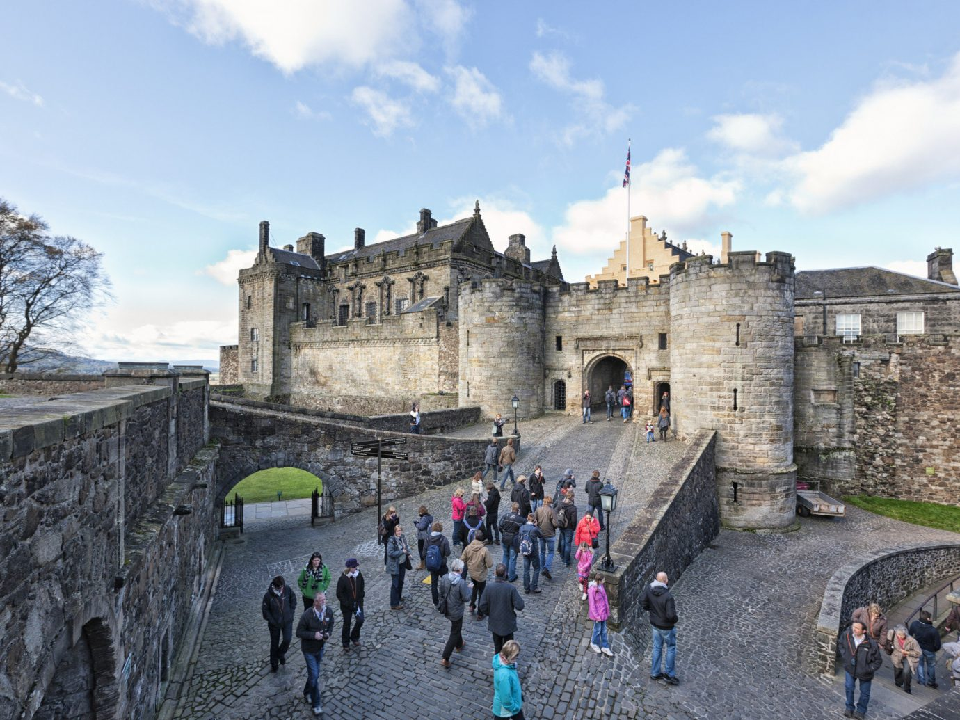 Landmarks Offbeat sky outdoor castle wall building fortification château historic site medieval architecture people group history tours tourist attraction tourism middle ages palace stone several crowd