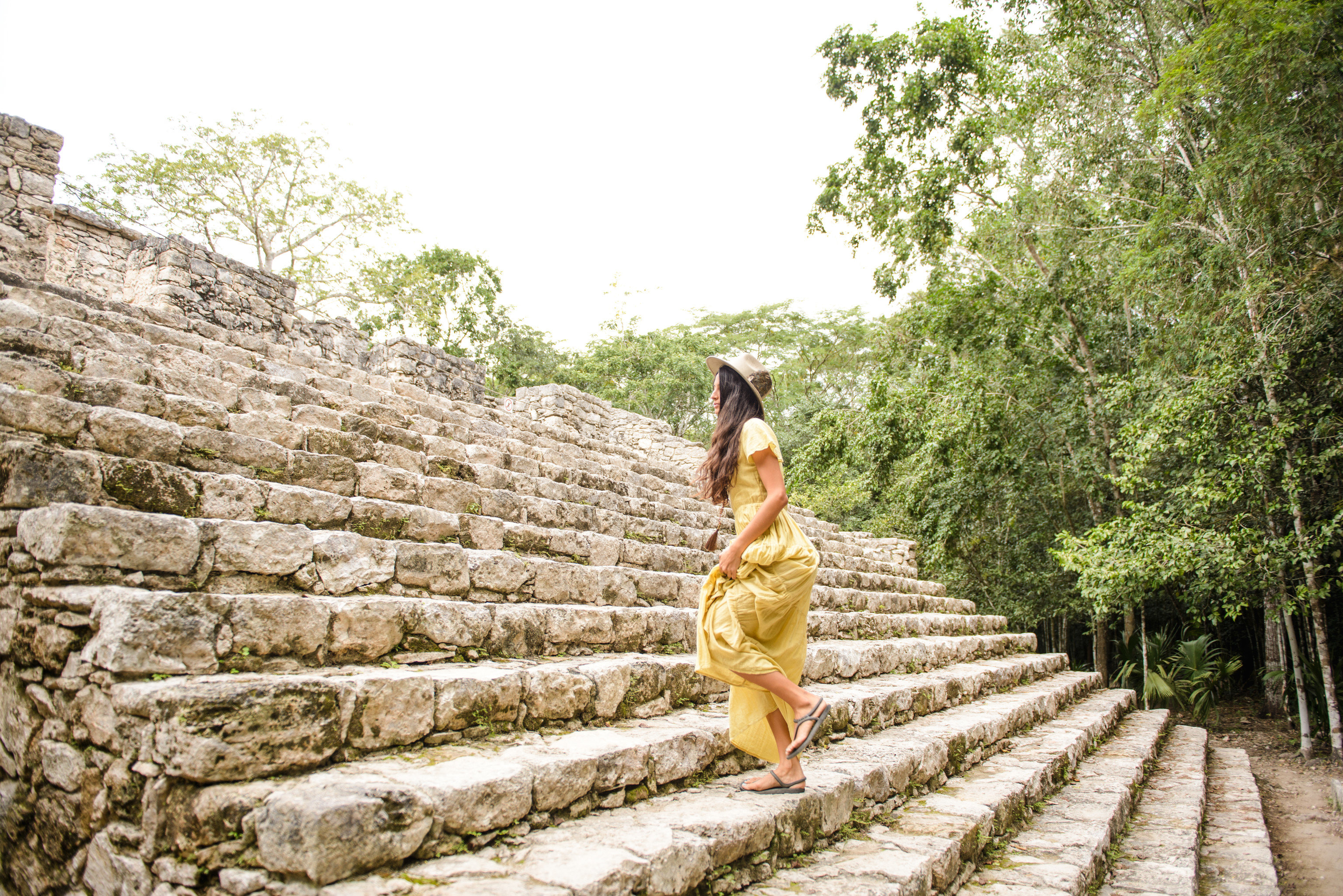City Mexico Trip Ideas Tulum outdoor tree rock temple outdoor structure girl tourism sky grass leisure archaeological site recreation stone