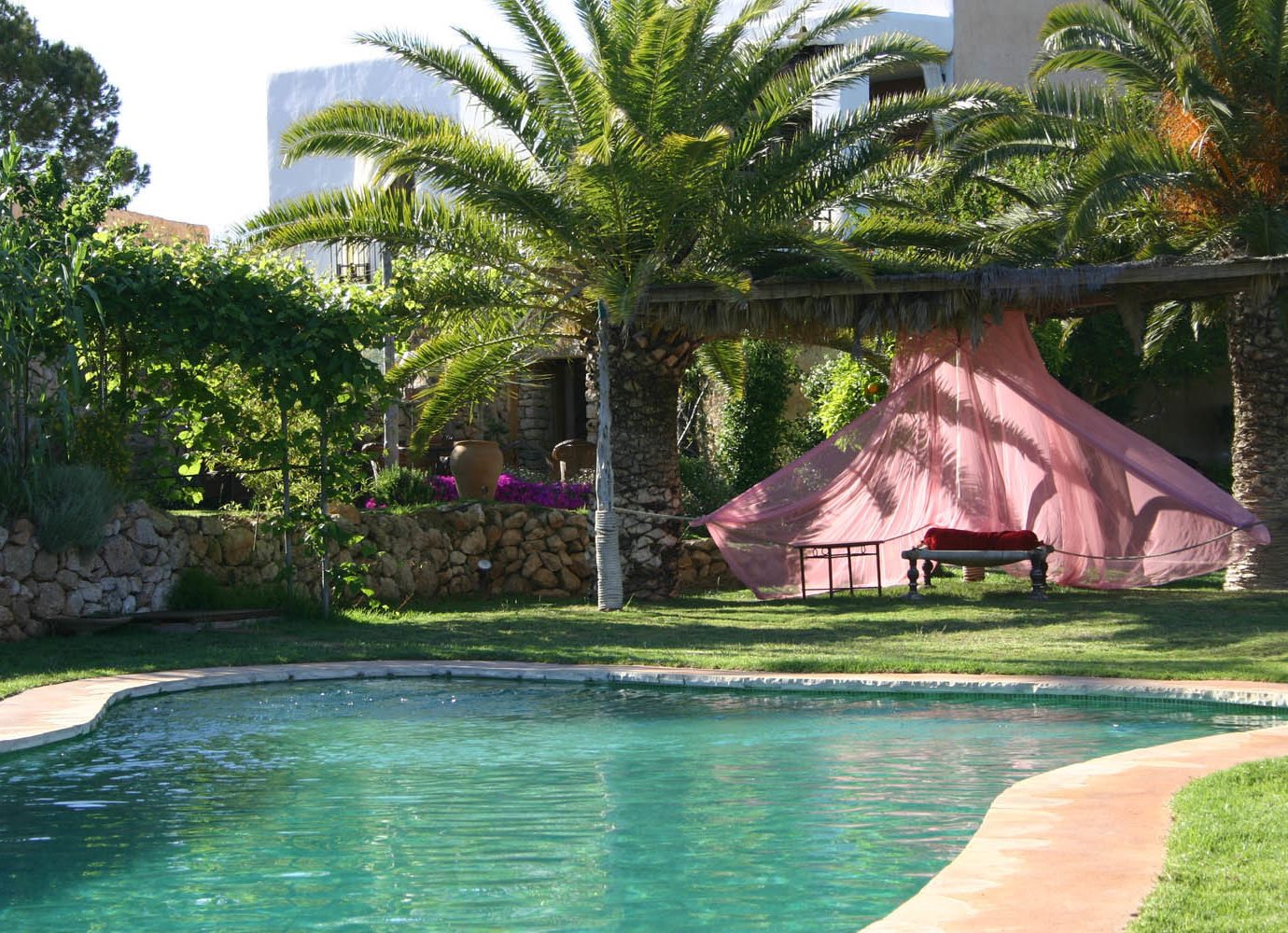 Boutique Hotels Hotels Luxury Travel Meditation Retreats Spa Retreats Trip Ideas Yoga Retreats tree outdoor grass water property Resort swimming pool arecales palm tree estate plant leisure real estate Pool house home Villa hacienda cottage reflection tropics landscape backyard landscaping plantation outdoor structure pond swimming