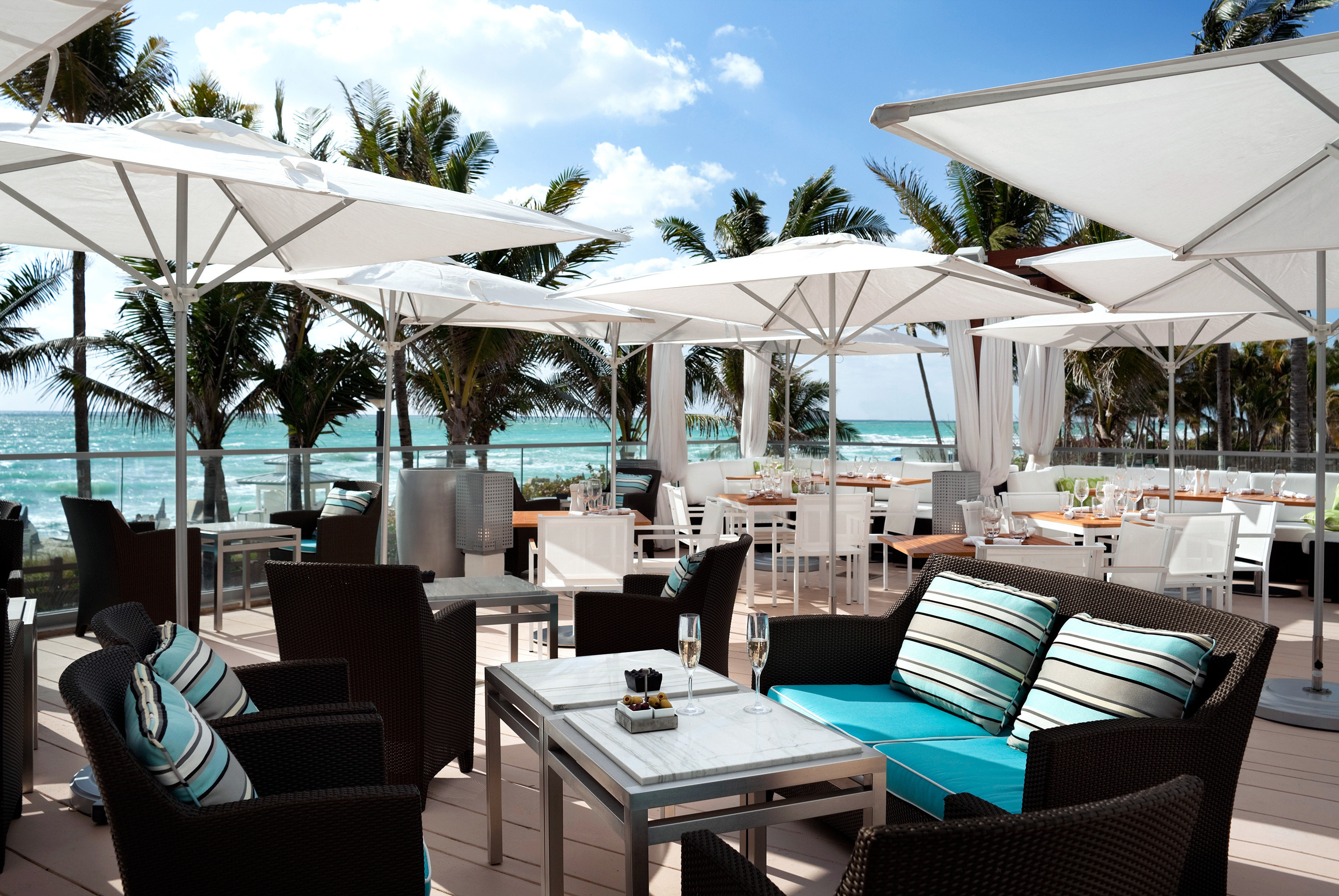Balcony Dining Drink Eat Hotels Outdoors Patio Resort sky outdoor table tree chair restaurant vacation estate caribbean yacht furniture vehicle Boat area set Deck several